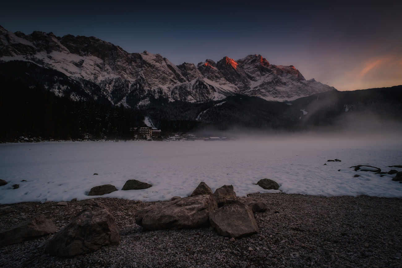 Eibsee at sunset Mountain Lake Landscape Rock - Object Mountain Peak Sunset Idyllic No People Nature Scenics Outdoors Snow Sky Natural Parkland Power In Nature Edited Winter Ice Fujifilm Cold Temperature Beauty In Nature Fuji Nature Taking Photos Vacations