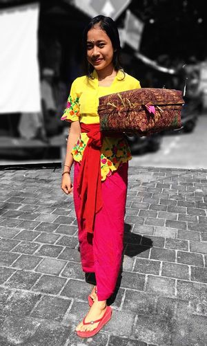 Indonesian outfits Only Women Happiness Street Smiling Portrait Full Length Lifestyles Outdoors Front View Young Women Tropical Climate Bali, Indonesia Close-up Pink Color Beauty