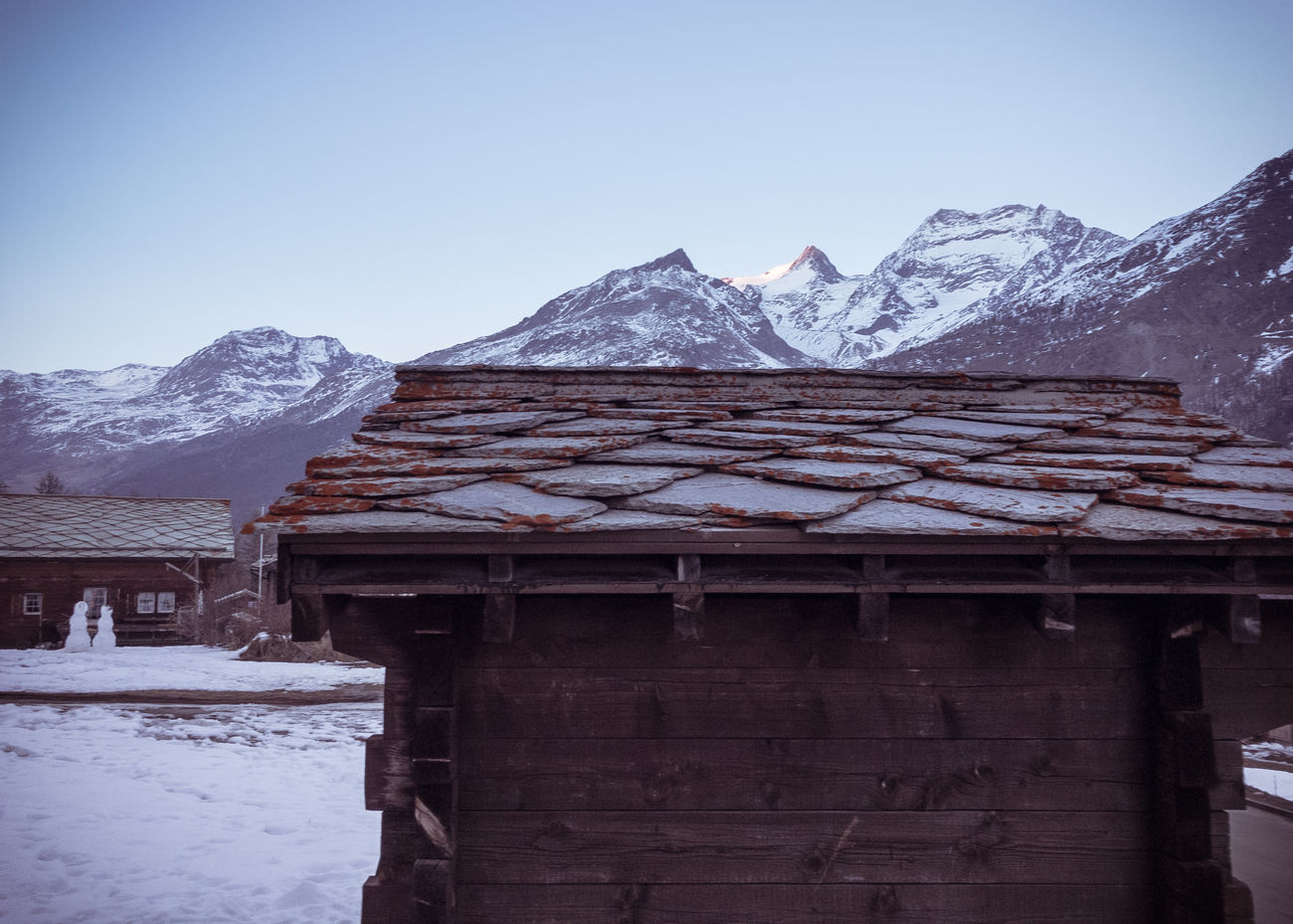 Agricultural Building Barn Lowlight Motion Blur Mountain Range Snow Snowman Switzerland Alps Valais Vignette