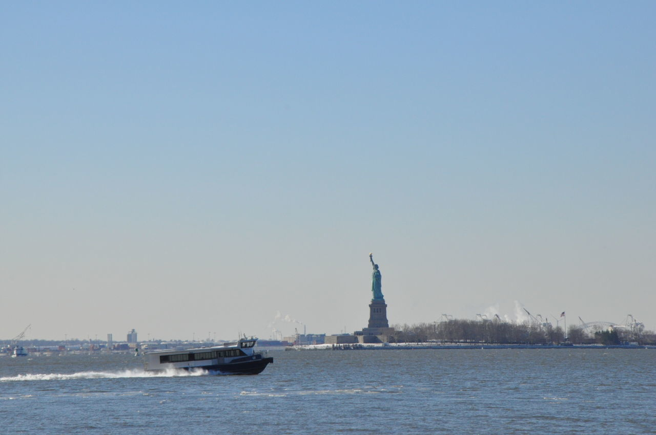 Beautiful stock photos of statue of liberty, Boat, Clear Sky, Copy Space, Day
