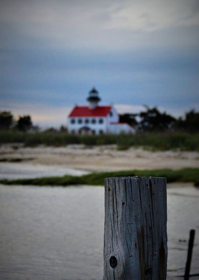 Dusk Sky Lighthouse Nature Architecture Bay Beach Beauty In Nature Building Exterior Built Structure Close-up Day Nature No People Outdoors Red Roofs Reeds Scenic View Scenics Sea Sky Tall - High Tranquility Water Wood - Material