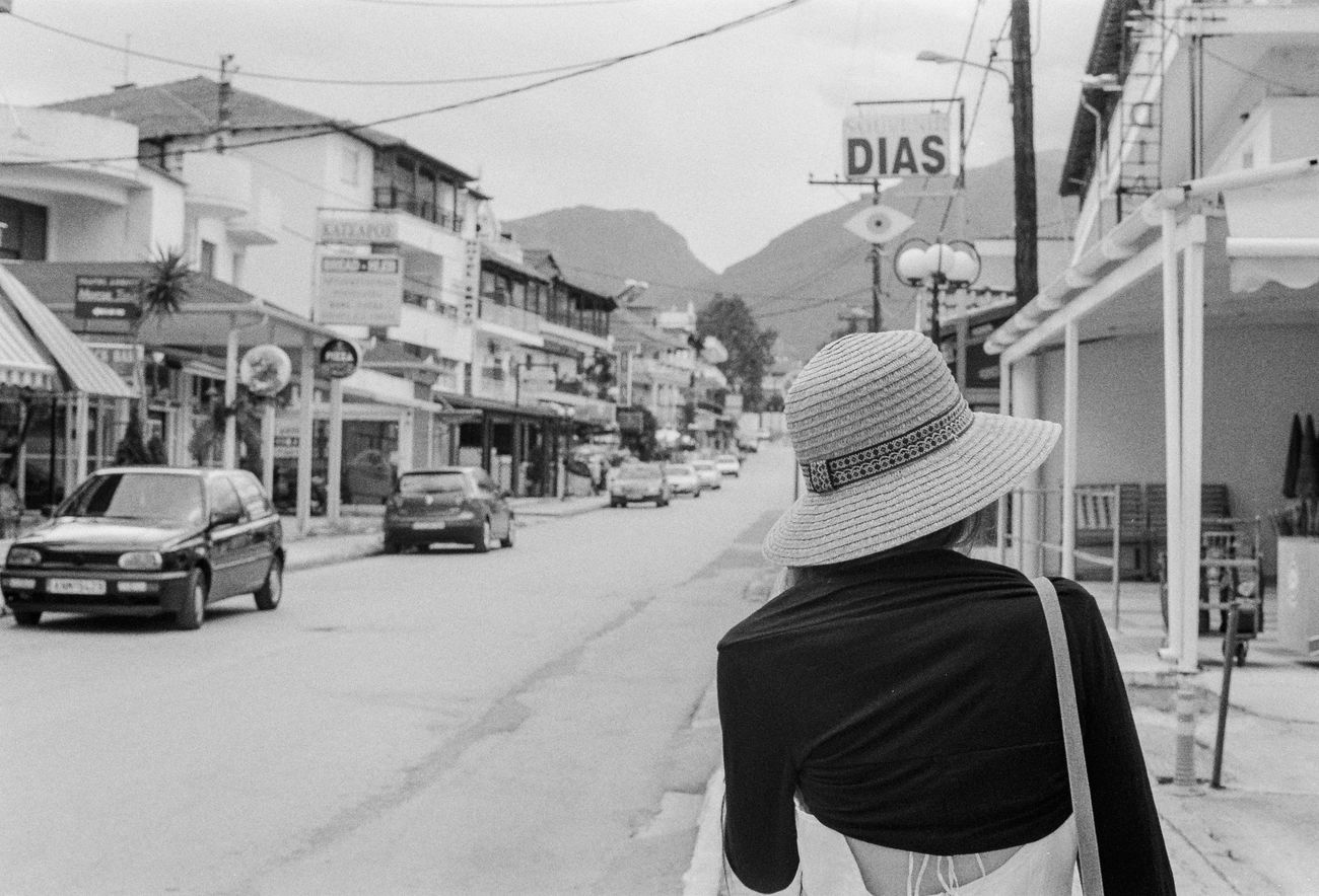 Analogue Photography Blackandwhite City City Street Day Hat One Person Person Real People Rear View Street Woman