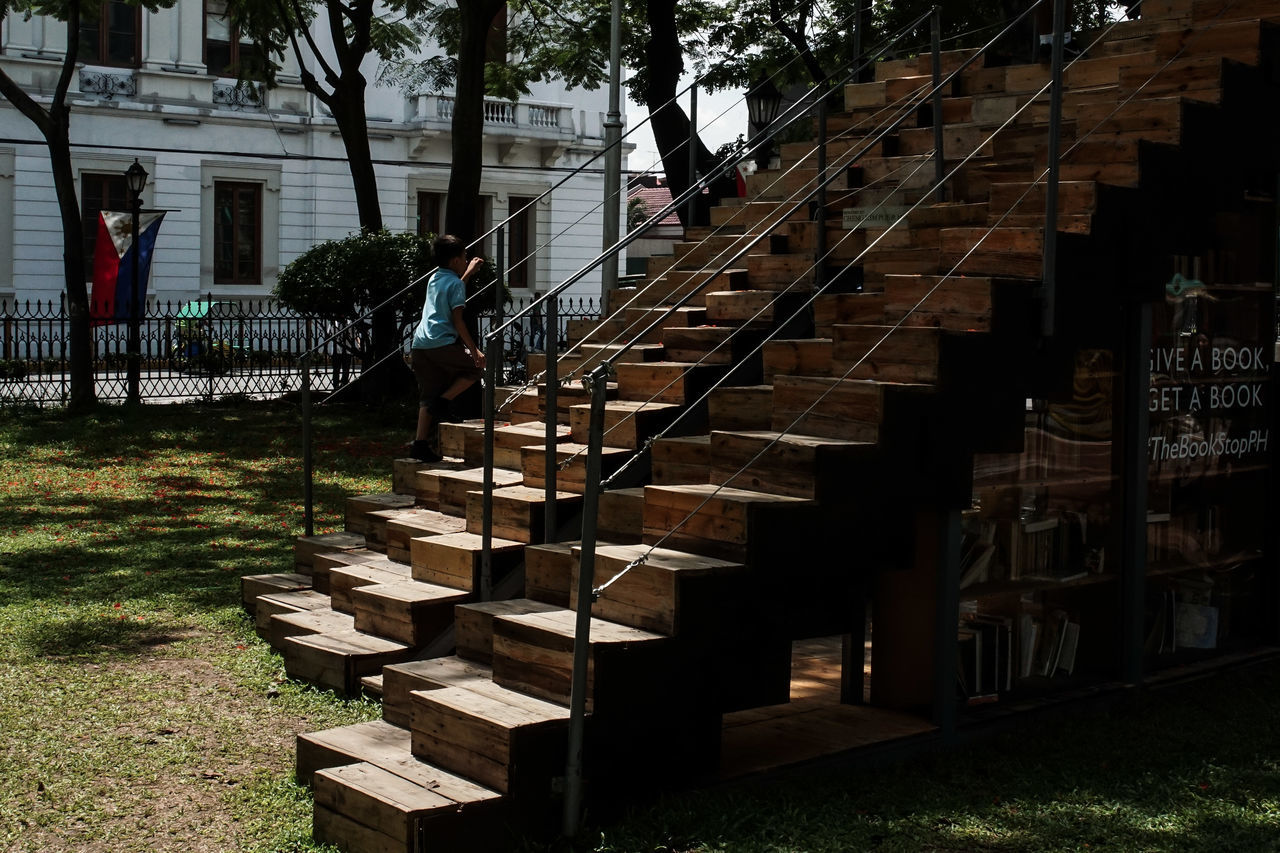 architecture, steps, built structure, staircase, steps and staircases, railing, outdoors, real people, day, one person, building exterior, tree