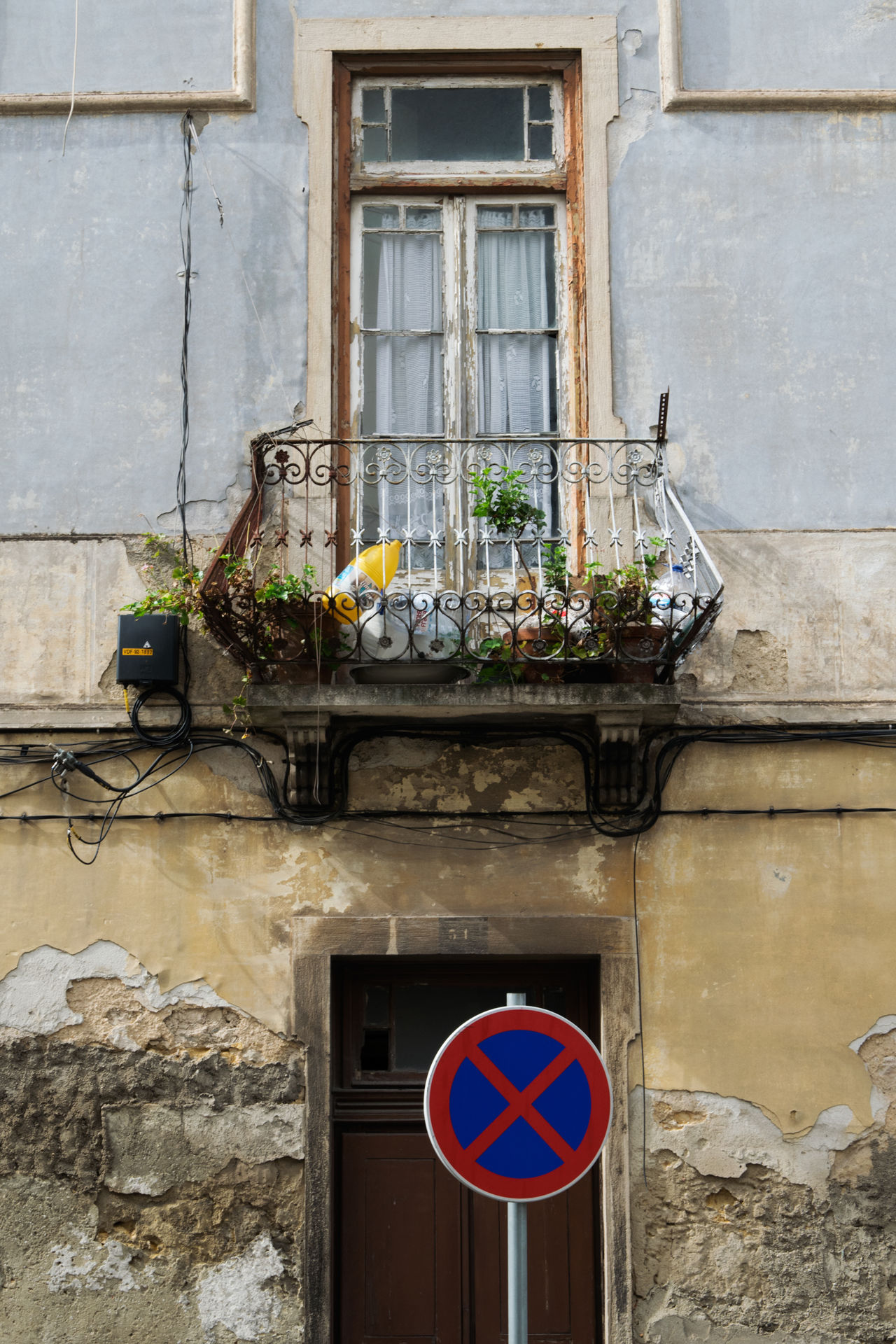 View of Amadora, suburb of Lisbon in Portugal Amadora Architecture Balcony Building Exterior Built Structure Day Flower No Parking Sign No People No Stopping Sign Outdoors Plant Portugal Window Window Box
