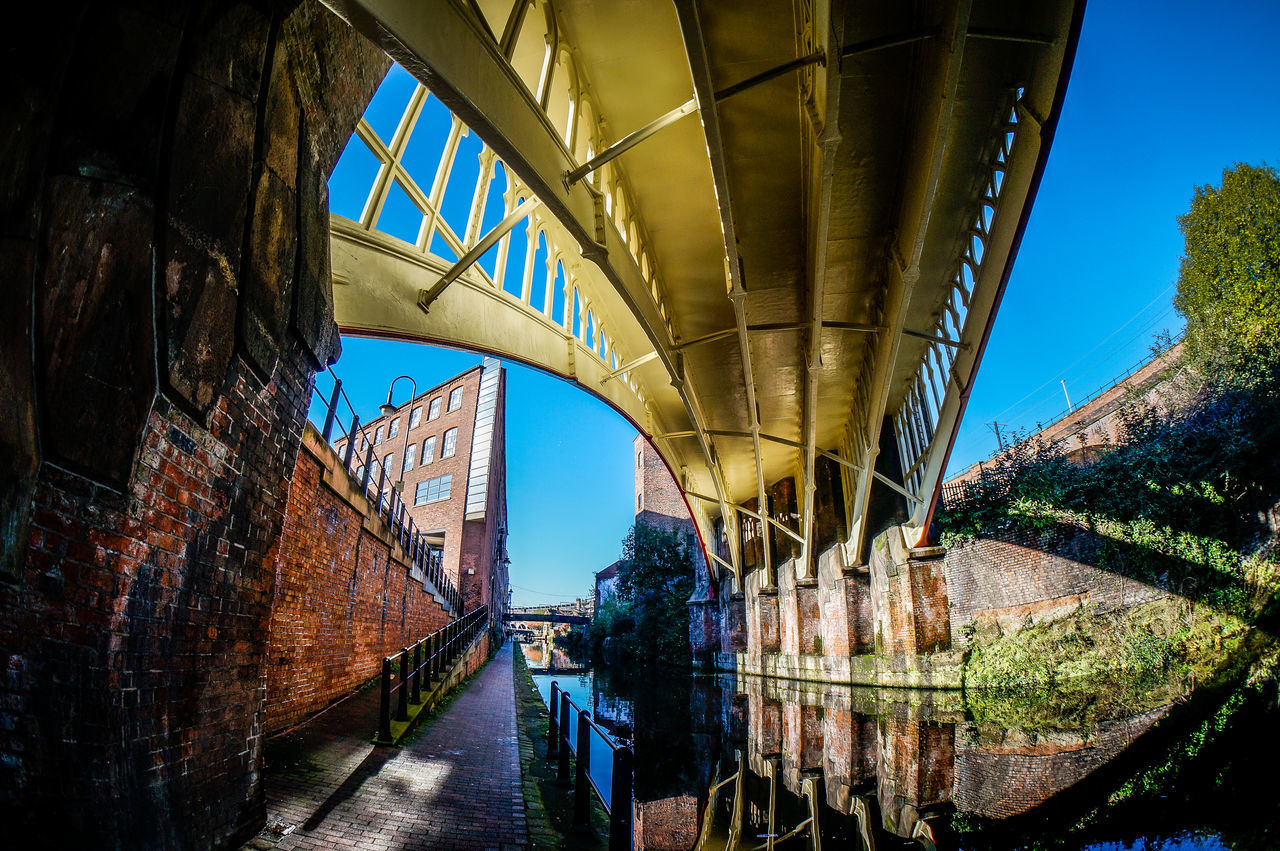 Bridge over the canal Abandoned Arch Architecture Bridge Bridge - Man Made Structure Building Exterior Built Structure Canal City Connection Diminishing Perspective Engineering Footbridge Leading Long Manchester Narrow Perspective Railing Ruined SonyNEX5n The Way Forward Transportation