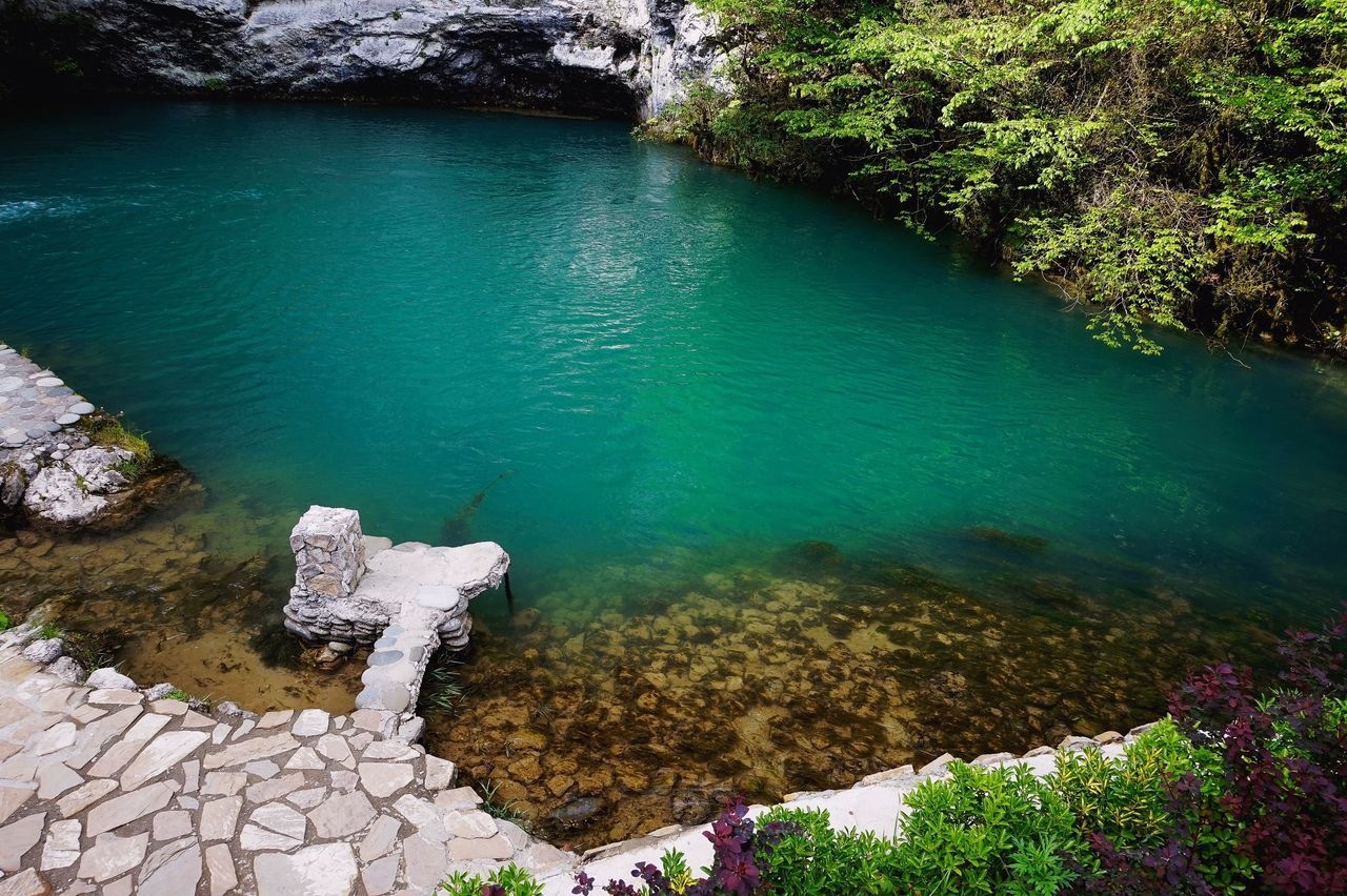 water, rock - object, nature, high angle view, beauty in nature, day, no people, tree, outdoors, tranquility, lake, scenics