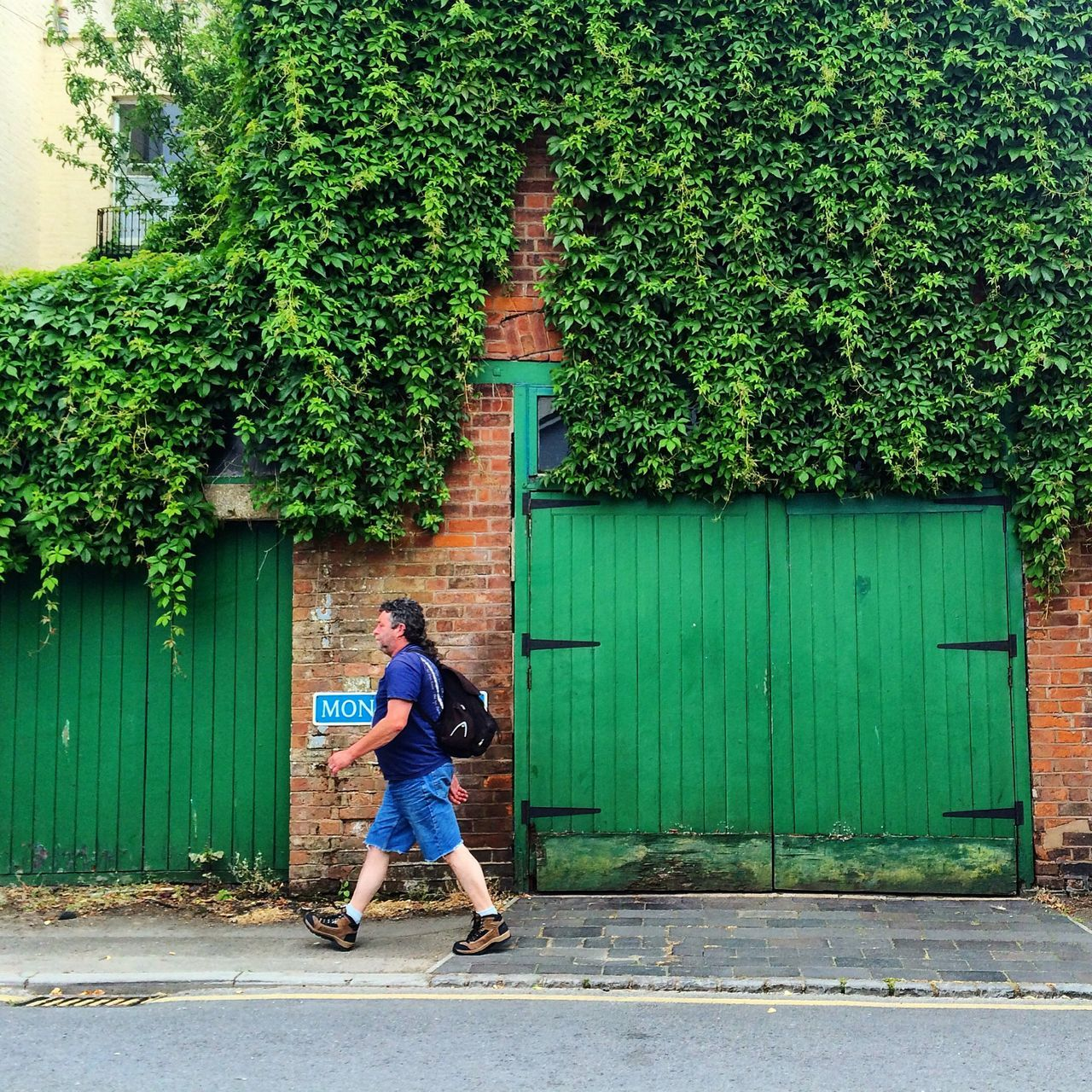 one person, one man only, green color, building exterior, built structure, architecture, outdoors, full length, only men, casual clothing, day, tree, real people, men, adults only, adult, young adult, people