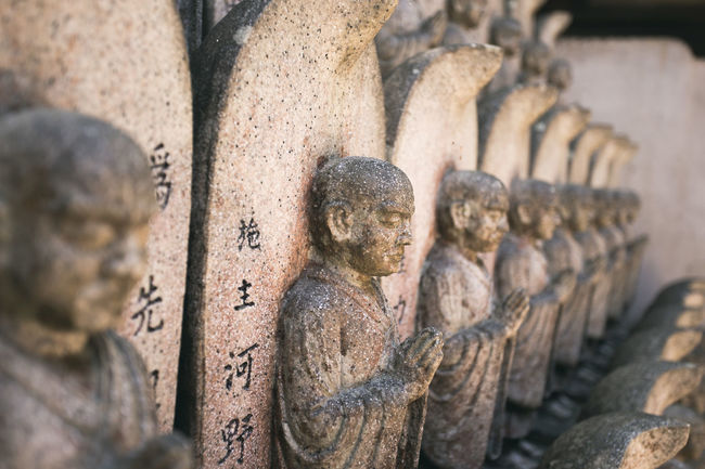 Ancient Art Art And Craft Carving - Craft Product Close-up Creativity Damaged Deterioration Focus On Foreground History Human Representation In A Row Old Place Of Worship Religion Ruined Sculpture Selective Focus Spirituality Statue Stone Stone Material Temple - Building The Past Weathered