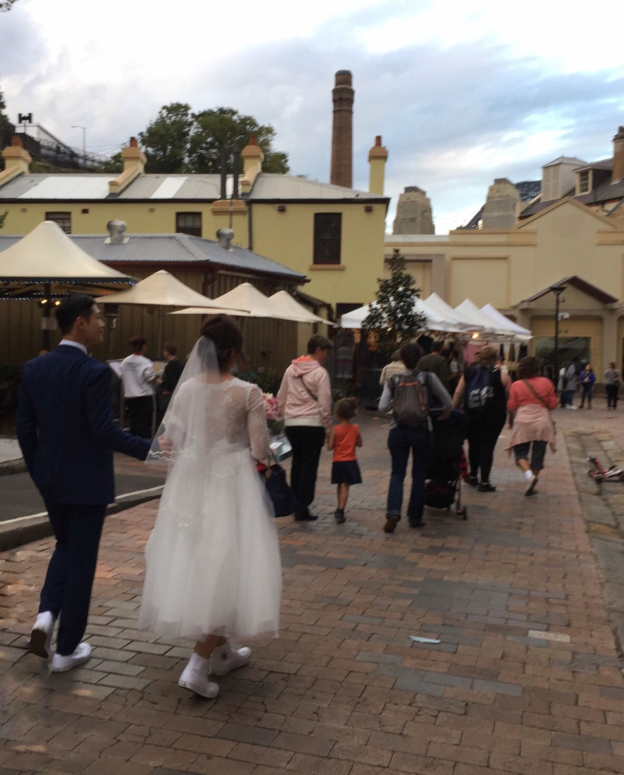 The Street Photographer - 2017 EyeEm Awards Real People Building Exterior Built Structure Celebration Men Walking Women Architecture Celebration Event Wedding Togetherness Rear View Day Large Group Of People Outdoors Lifestyles Full Length Bride Groom Sky (null)Getting Married The Rocks Sydney