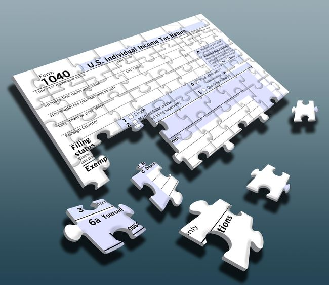 The annual puzzle of putting together a income tax return is represented in this 3-D illustration of a 1040 tax form made of puzzle pieces. 104 Form Incomplete Blue Blue Background Illustration Incidental People Jigsaw Puzzle Pieces Puzzle