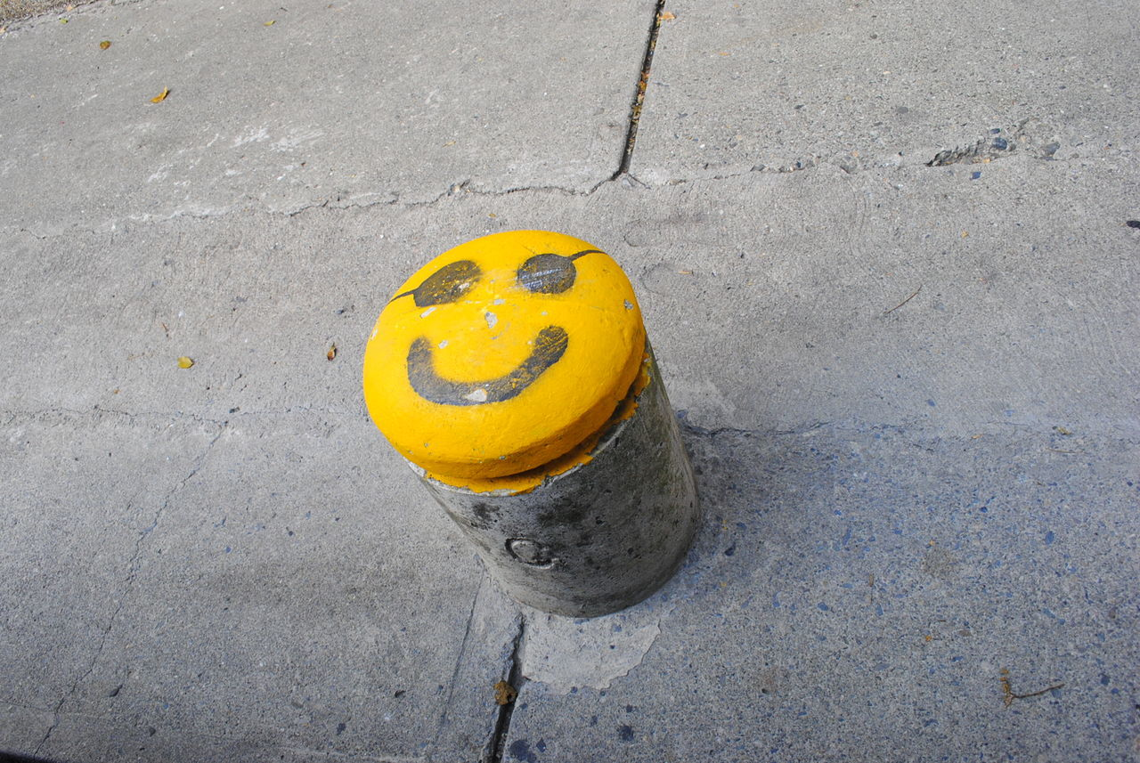 Anthropomorphic Face City Day Funny Faces High Angle View No People Outdoors Smile Smiley Face Yellow