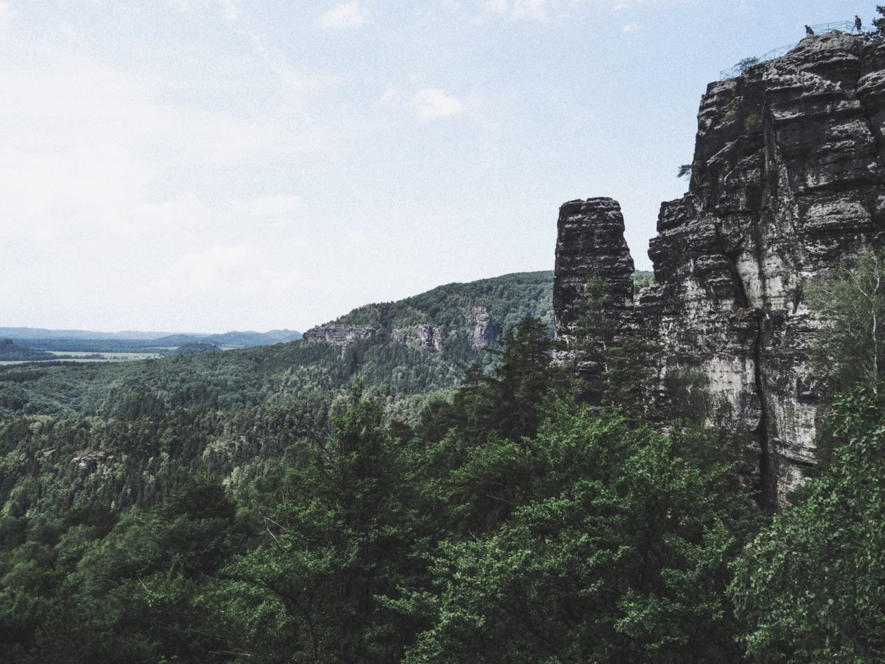 Sky Nature Day Tree Mountain Low Angle View No People Cliff Outdoors Beauty In Nature Traveling Travel Destinations View From Above Sächsische Schweiz Prebischtor Böhmische Schweiz Rock Formation Rock Stone Travel Tranquil Scene Landscape Rocks Mountain View Forest