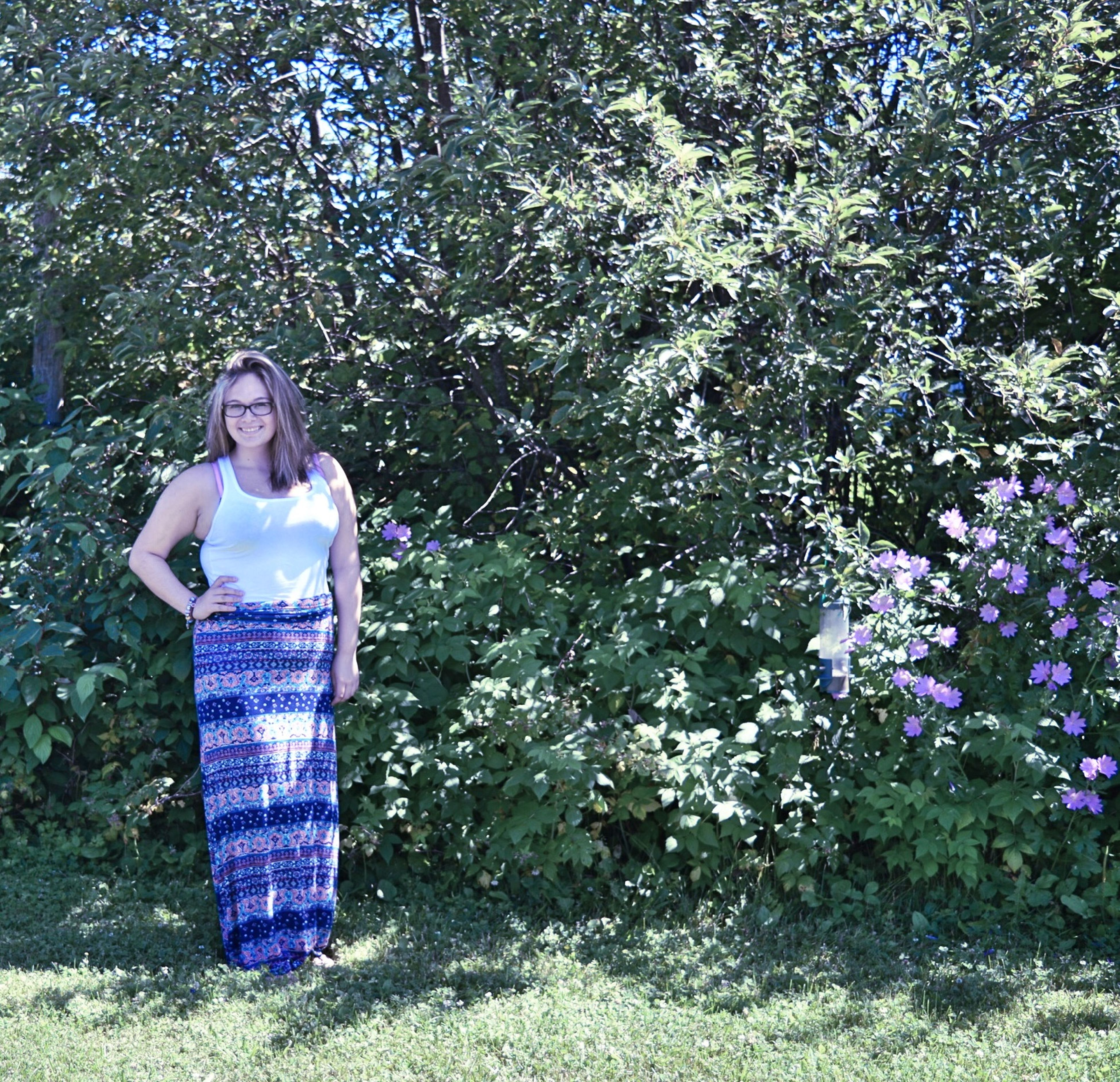 casual clothing, lifestyles, leisure activity, person, tree, full length, childhood, growth, standing, nature, plant, elementary age, grass, beauty in nature, tranquility, girls, day, forest