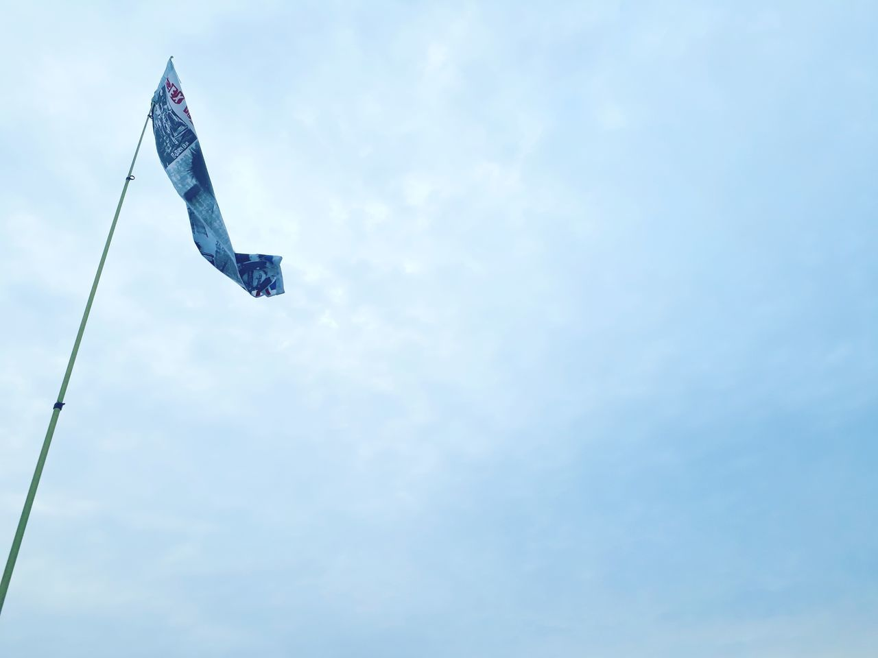 low angle view, sky, cloud - sky, wind, flag, day, outdoors, no people, nature