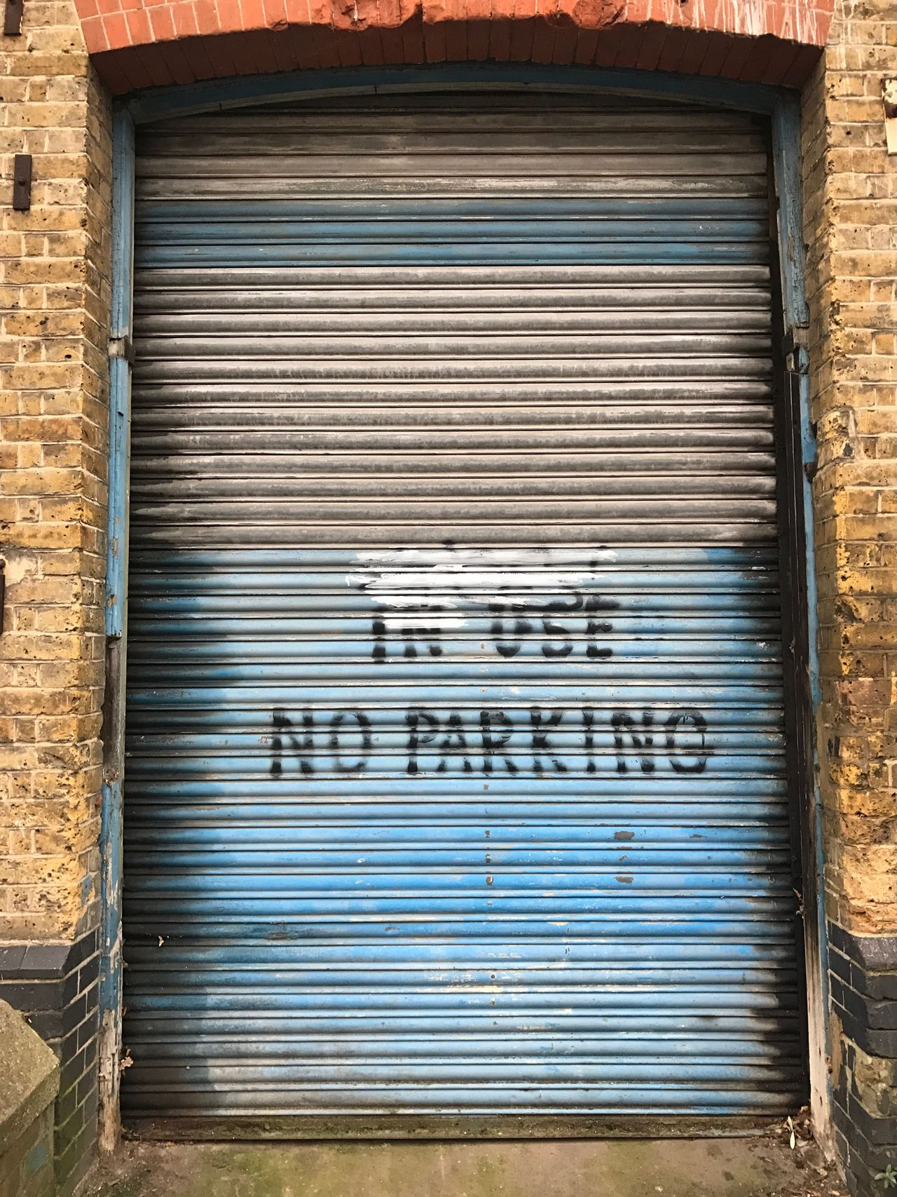 Shutter Corrugated Iron Corrugated Built Structure Closed Building Exterior Outdoors No People Day Architecture Close-up No Parking No Parking Sign Brick Wall Bricks