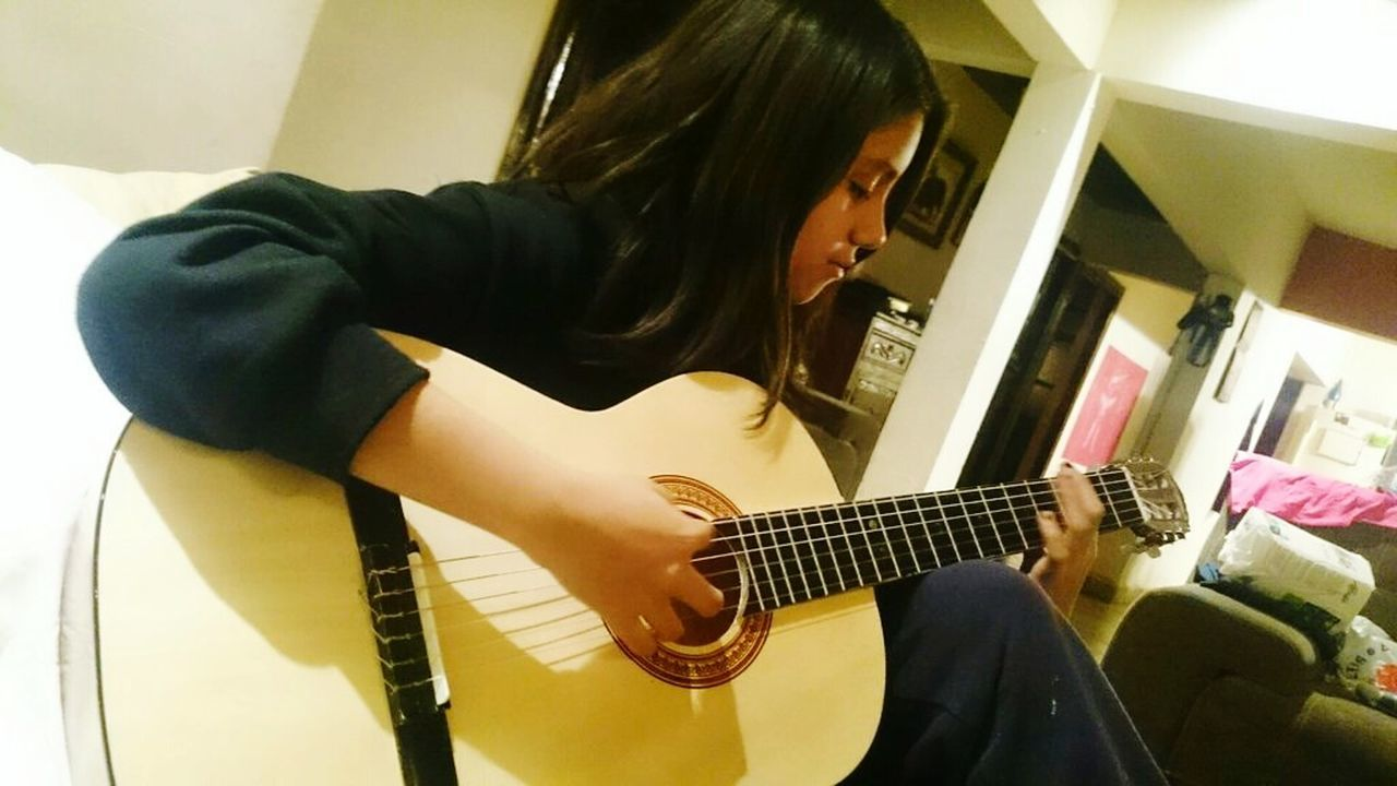Learning Guitar Lessons Mi Hija