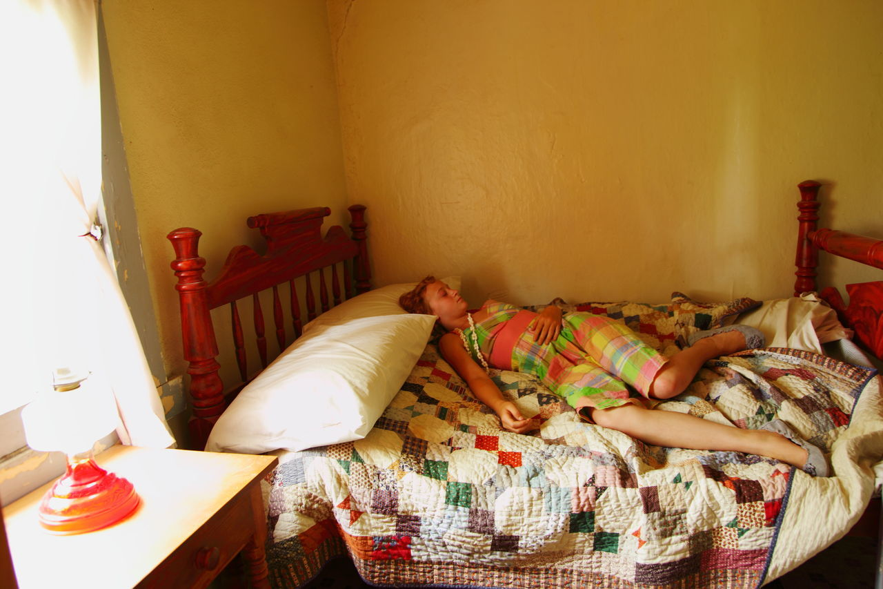Girl Sleeping On Bed At Home