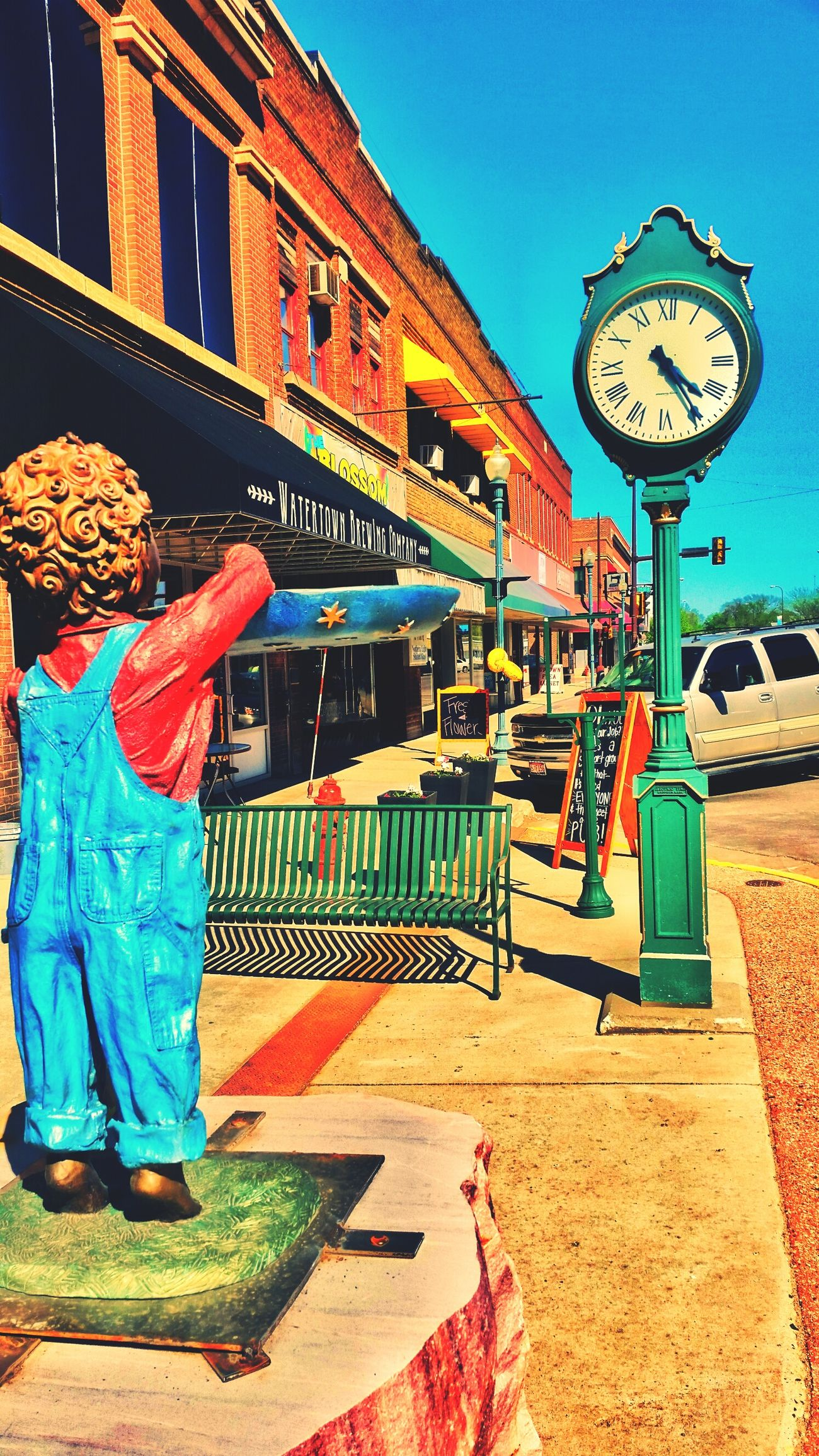 Time is Short Clock Clockwork Clock Tower Clock Structure Boy Overalls Offering Day Daylight Sunny Sunny Day Empty Street Empty Sidewalk Brewing Beer Brewing Company Baloons Signs Business Downtown Downtown District Watertown No People Building Exterior Architecture Outdoors