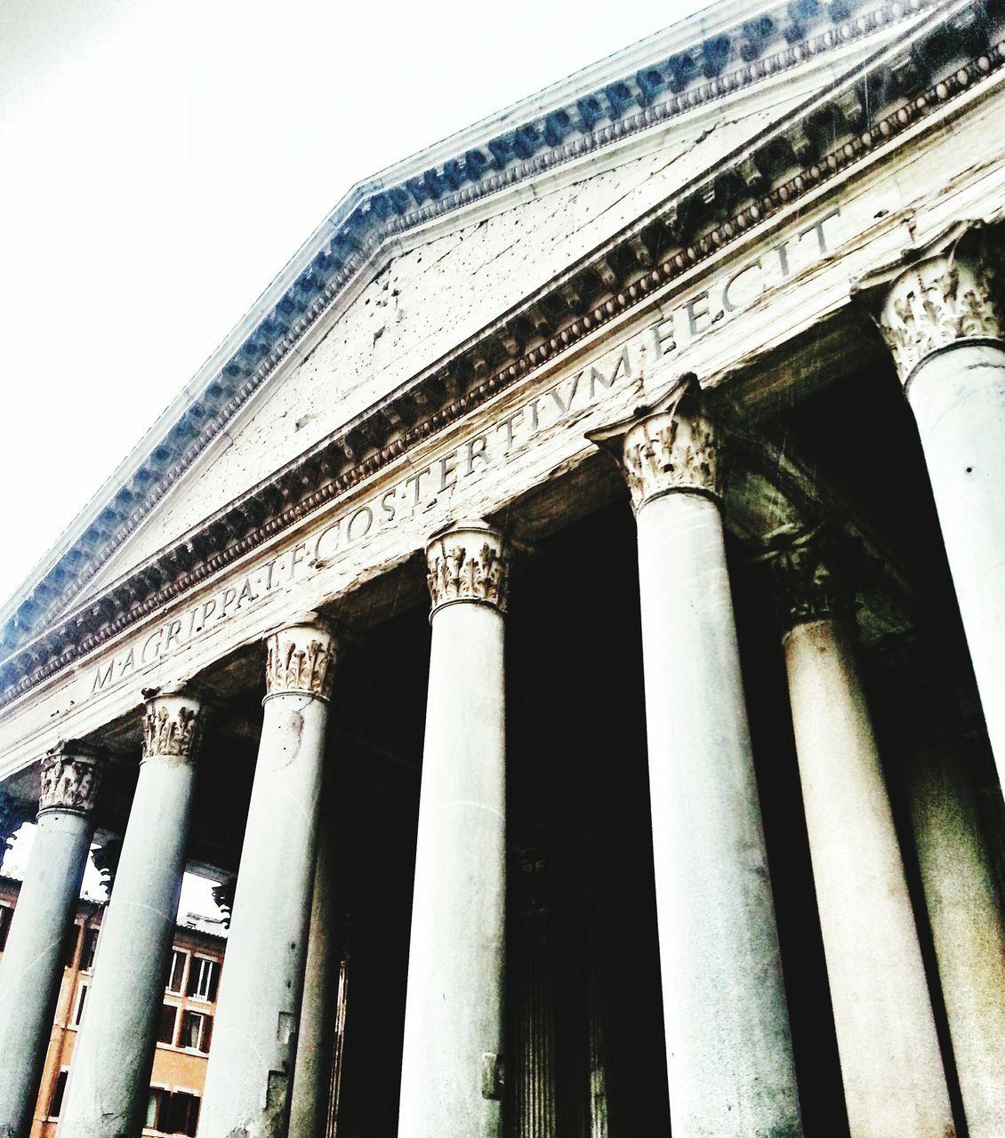 architectural column, architecture, built structure, low angle view, history, building exterior, pediment, outdoors, no people, travel destinations, pillar, day, ancient, sky, ancient civilization