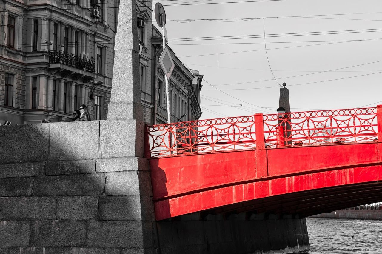 architecture, red, built structure, building exterior, connection, outdoors, transportation, day, no people, city, sky