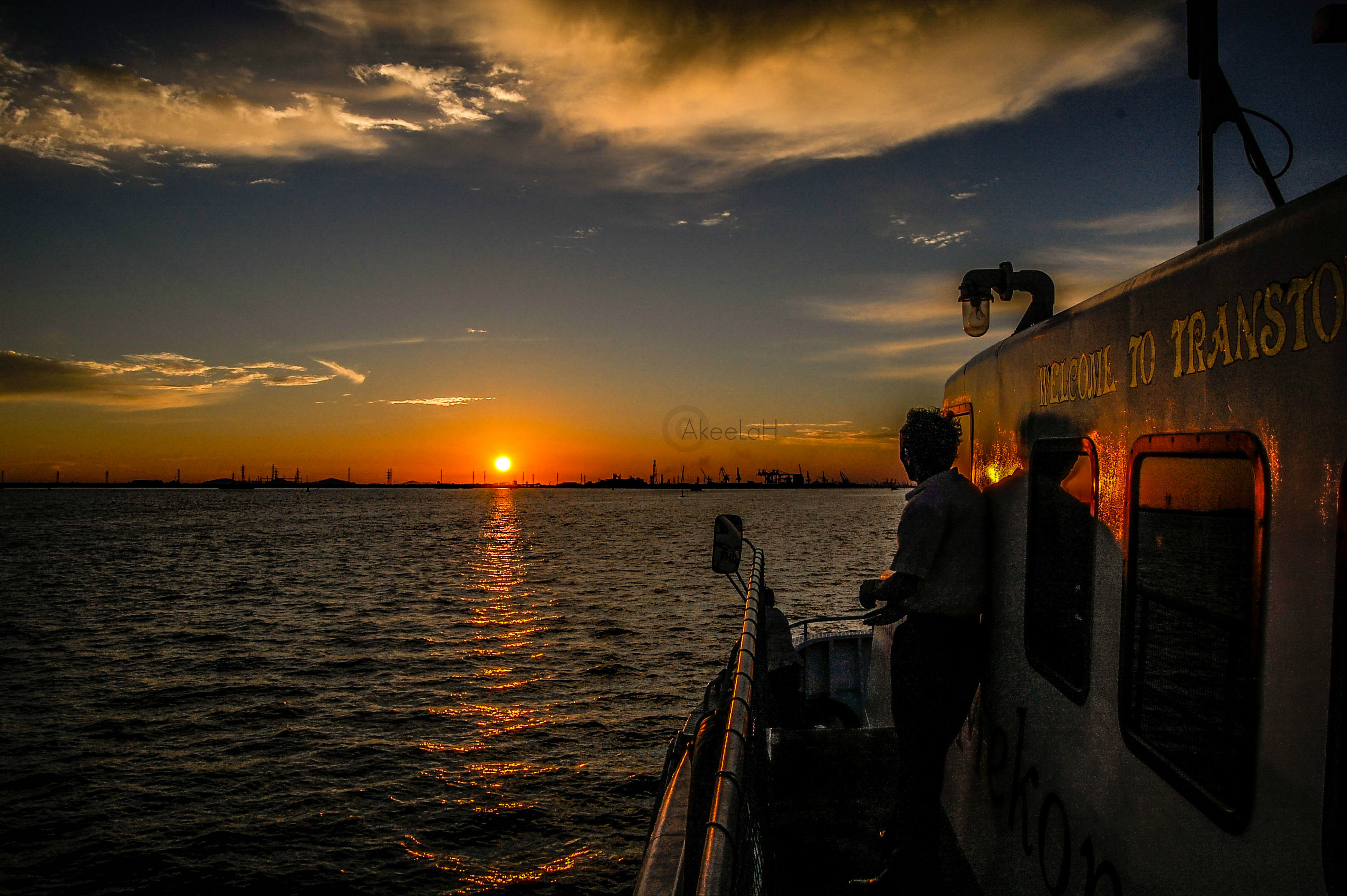 sunset, water, sky, sea, cloud - sky, transportation, nautical vessel, orange color, silhouette, mode of transport, scenics, sun, beauty in nature, horizon over water, nature, boat, cloud, tranquility, tranquil scene
