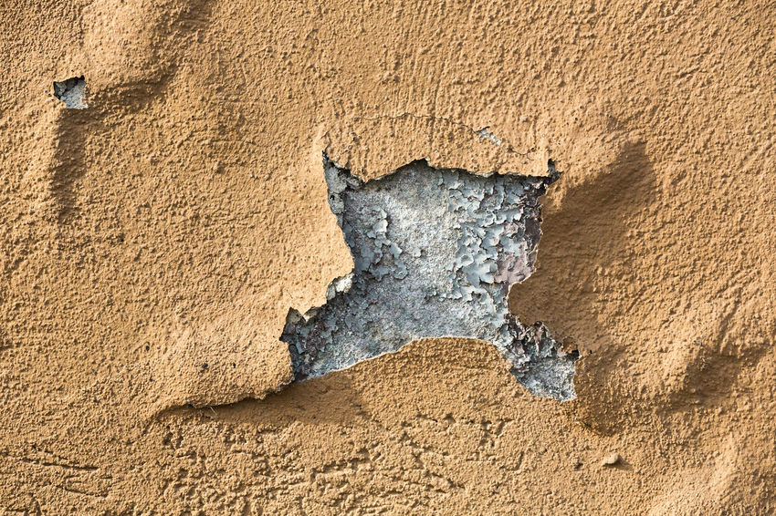 Cracked plaster on facade peeling off Aging Process Backgrounds Beige Building Exterior Bumpy Close-up Concrete Cracked Damaged Day Deterioration Full Frame Gray No People Old Outdoors Paint Peeling Off Plaster Run-down Textured  Wall - Building Feature Weathered Wrinkled Yellow