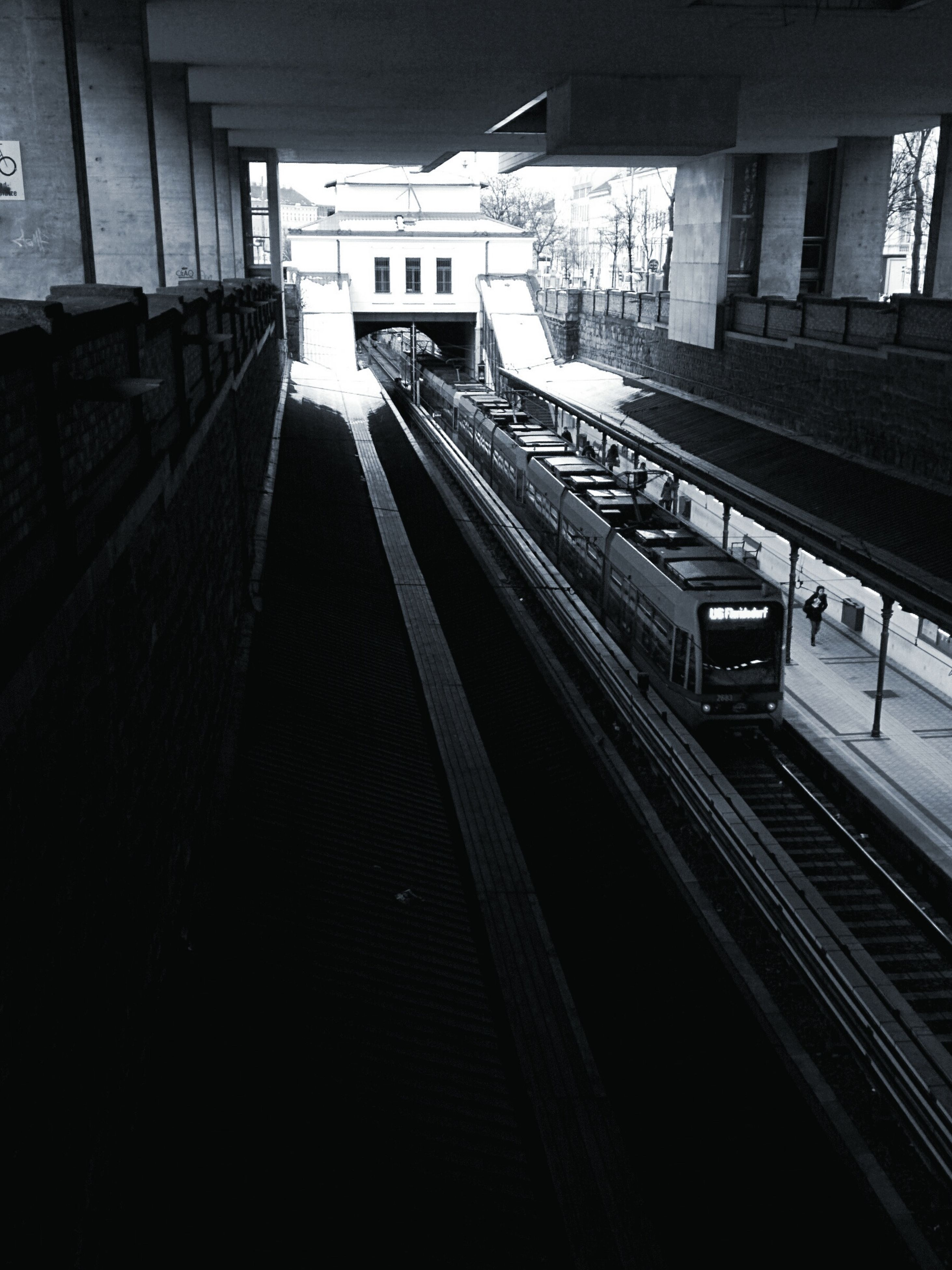 transportation, railroad track, public transportation, rail transportation, railroad station platform, railroad station, train - vehicle, mode of transport, built structure, architecture, public transport, passenger train, the way forward, travel, train, diminishing perspective, railway track, high angle view, journey, vanishing point