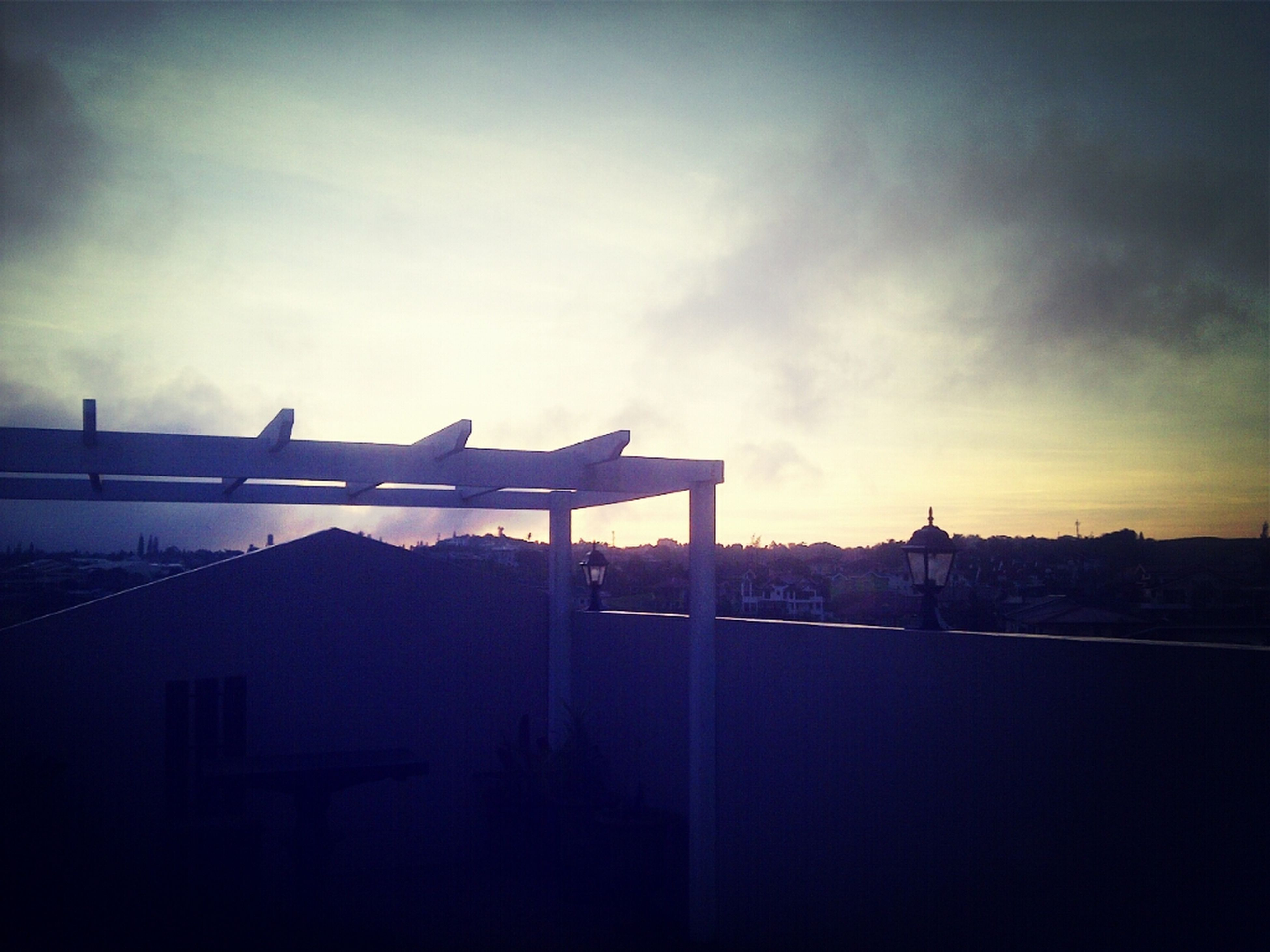architecture, built structure, building exterior, sky, water, silhouette, sunset, cloud - sky, railing, connection, sea, bridge - man made structure, cloud, dusk, river, outdoors, bridge, city, no people, nature