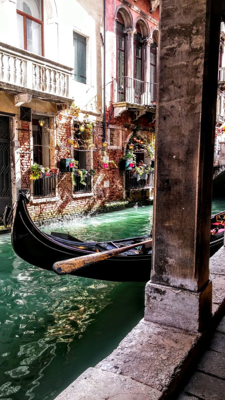 building exterior, architecture, built structure, canal, window, gondola, water, transportation, day, gondola - traditional boat, nautical vessel, outdoors, real people