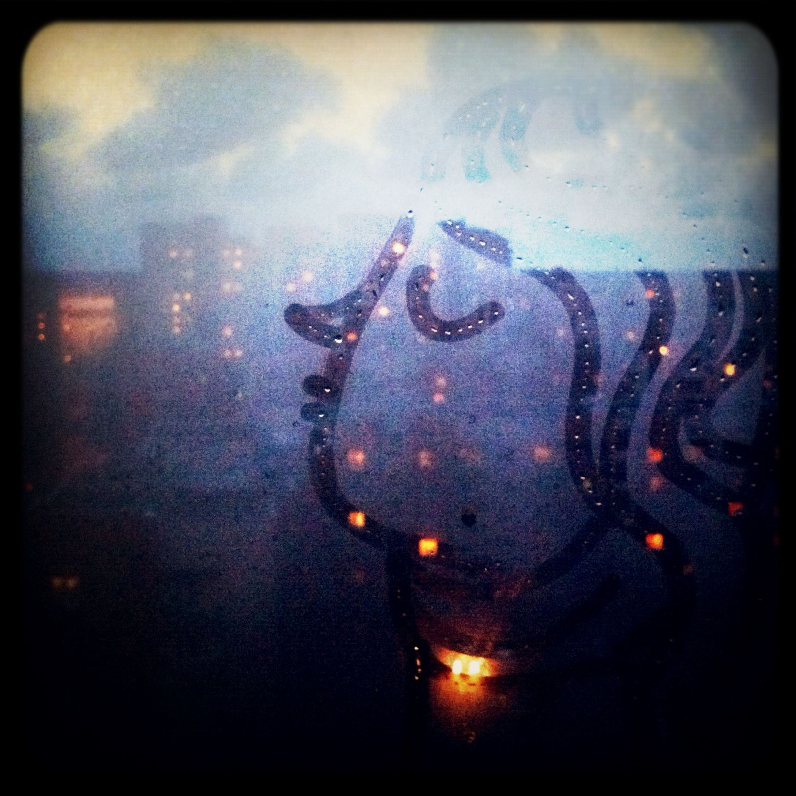 transfer print, water, auto post production filter, sky, glass - material, transparent, wet, transportation, weather, window, car, mode of transport, land vehicle, indoors, rain, sunset, dusk, cloud - sky, reflection, drop