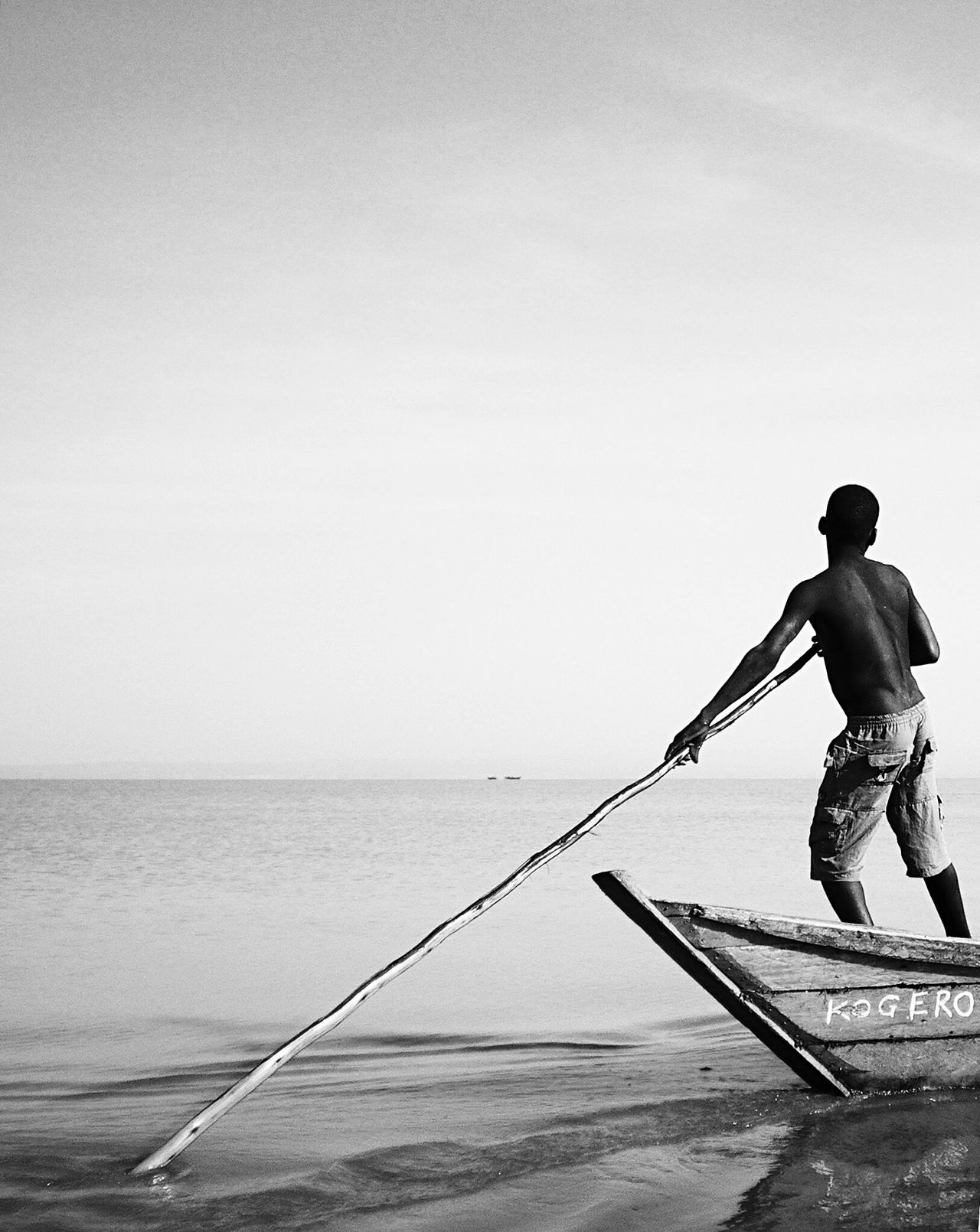 Real People Sea One Person Water Nautical Vessel Men Nature Full Length Day Fisherman Outdoors Occupation Clear Sky Sky Horizon Over Water Beauty In Nature Working Blackandwhite Kenya