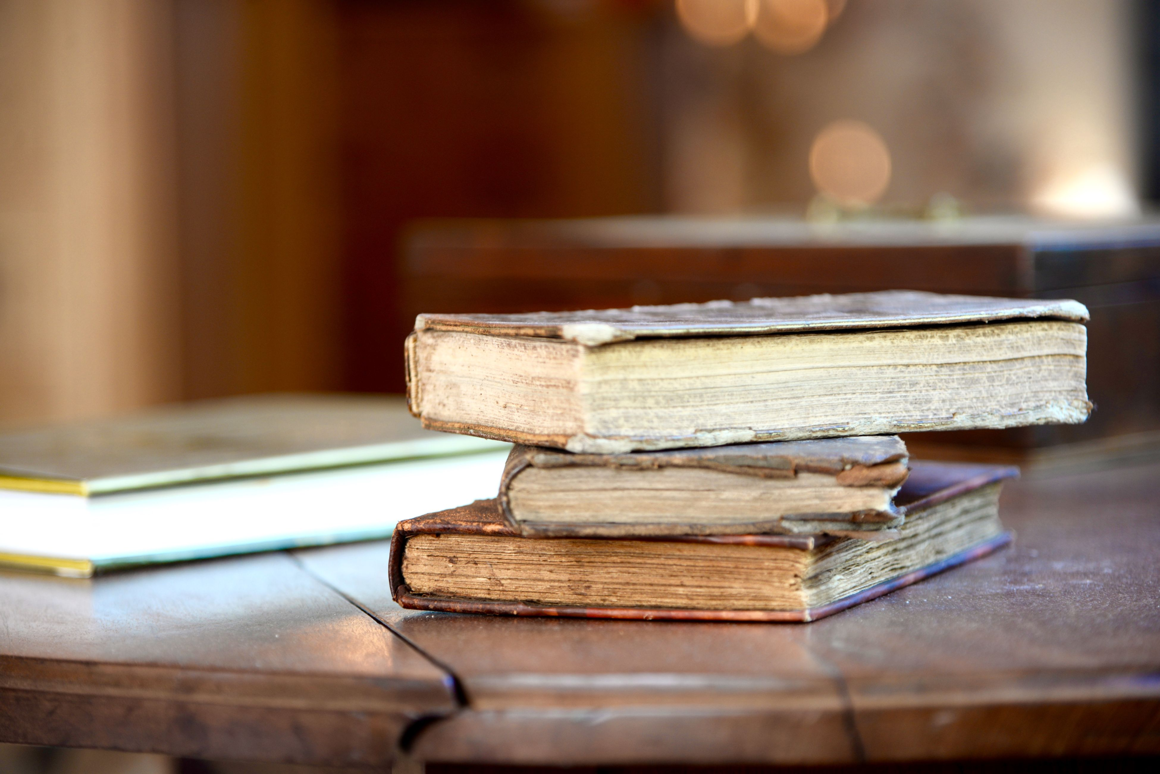 indoors, table, wood - material, still life, selective focus, close-up, focus on foreground, wooden, book, wood, no people, education, stack, absence, large group of objects, paper, group of objects, in a row, bench, pencil