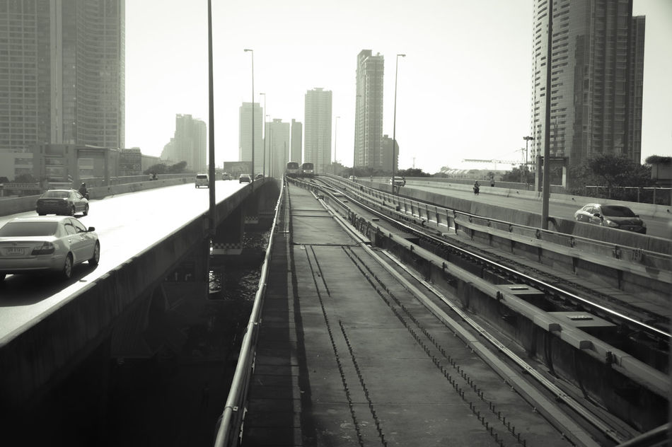 Skyscraper City Transportation Architecture Urban Skyline Built Structure Building Exterior Railroad Track No People Outdoors Travel Downtown District Public Transportation Cityscape Modern Travel Destinations Day Sky Subway Train Monochrome Photography Black And White Black And White Photography