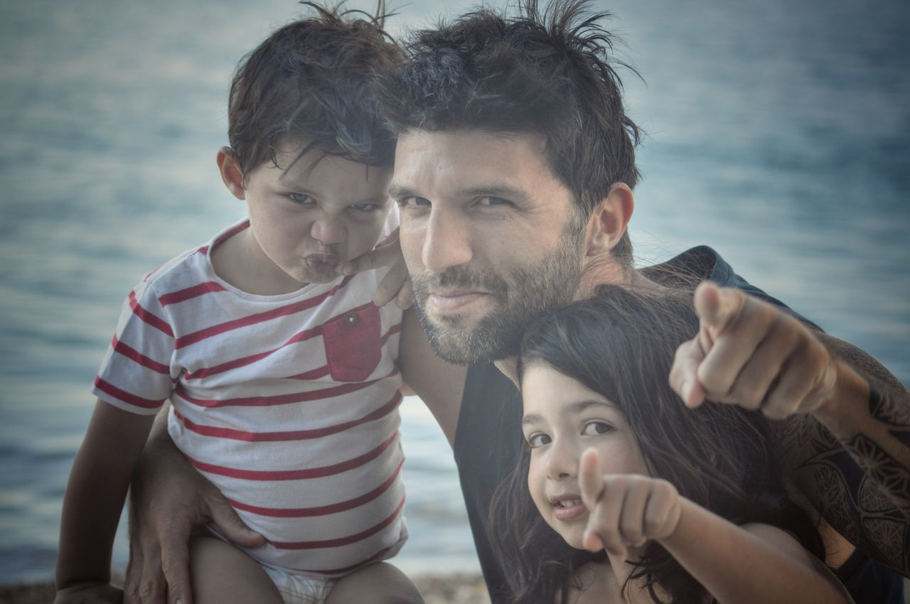"""""""We warned you! We are a wolfpack!"""" Fatherhood Moments Father & Son Father And Daughter My Kids Pure Love Capture The Moment Togetherness Pricelessmoments  Bonding Family Matters Family Power Looking At Camera Smiling Happy People Happiness Dad Love Memories Real People Childhood Hug Me"""