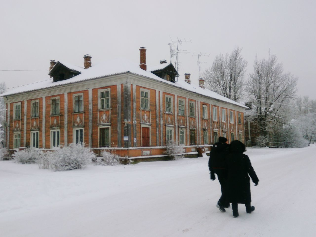 winter, snow, cold temperature, weather, building exterior, built structure, walking, full length, architecture, warm clothing, rear view, outdoors, real people, day, snowing, nature, tree, bare tree, women, snowdrift, sky, people