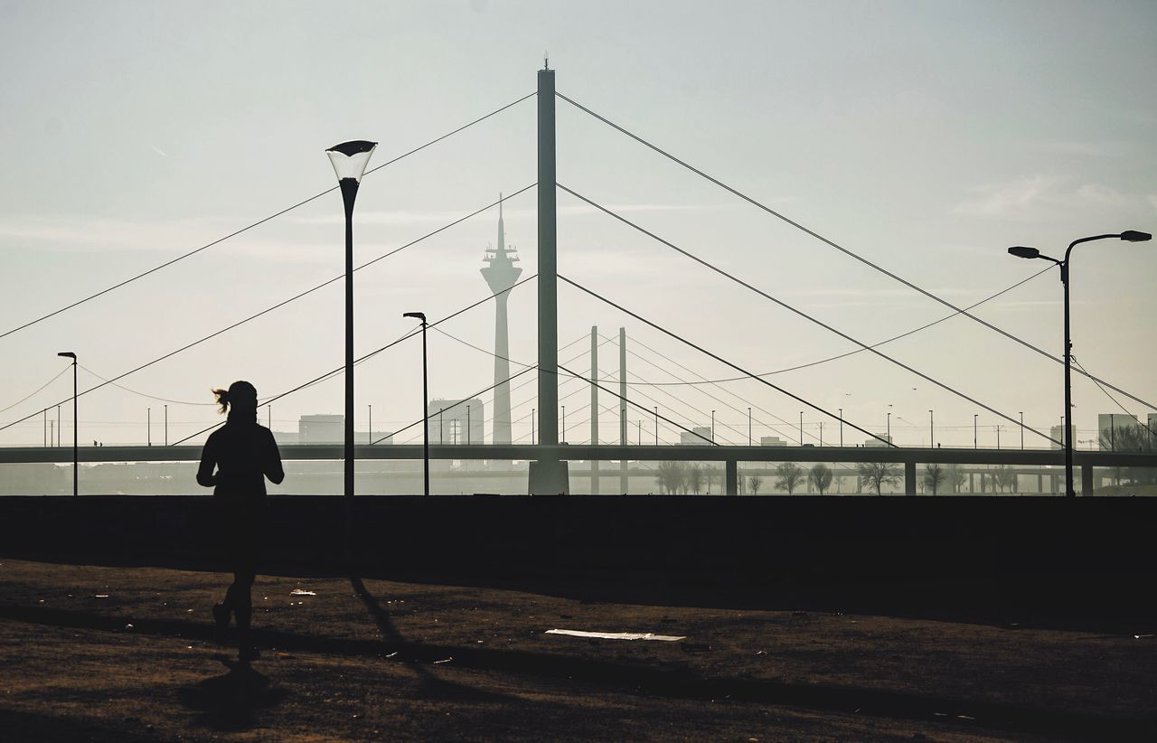 The City Light Lines Bridge Bridges Running Woman Full Length Sky Outdoors Real People One Person Cable Silhouette Connection Electricity Pylon Day Architecture Urban Urban Geometry Nikon D7000