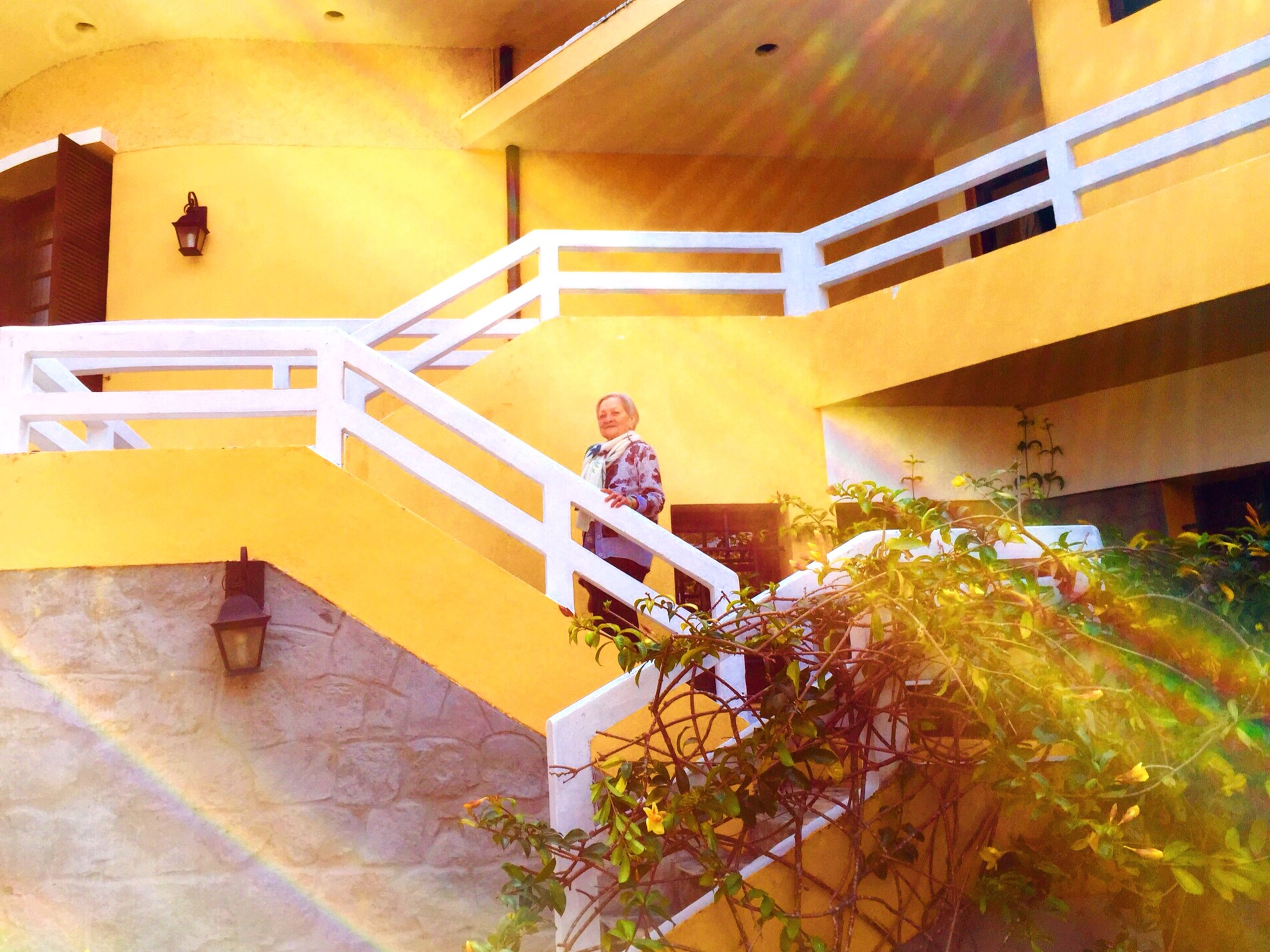 architecture, built structure, indoors, yellow, building exterior, steps and staircases, steps, staircase, building, house, wall - building feature, railing, ceiling, high angle view, lighting equipment, sunlight, day, no people, illuminated, low angle view