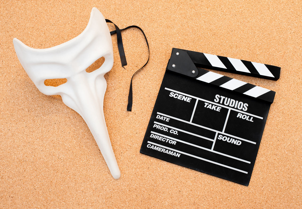 Movie clapper board and carnival theater mask Actor Carnival Character Cinema Clapboard Clapper Clapper Board Close-up Film Mask MOVIE No People Studio Shot Text Theater