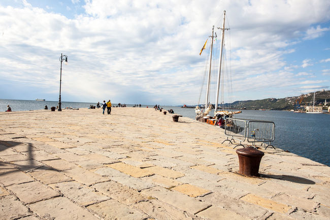 View of the Molo Audace in Trieste on Rive on a cloudy day of autumn Architechture Barcolana Barcolana48 City Cityscape Cloudy Day EyeEm Best Shots Hill Landscape Paving Stone Pier Regatta Sea Sky Stone Style Trieste TriesteSocial