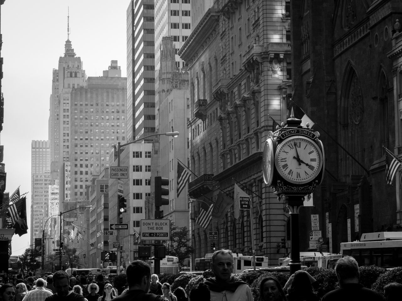 building exterior, architecture, city, built structure, clock, large group of people, time, street, skyscraper, city life, crowd, outdoors, real people, men, day, modern, cityscape, people