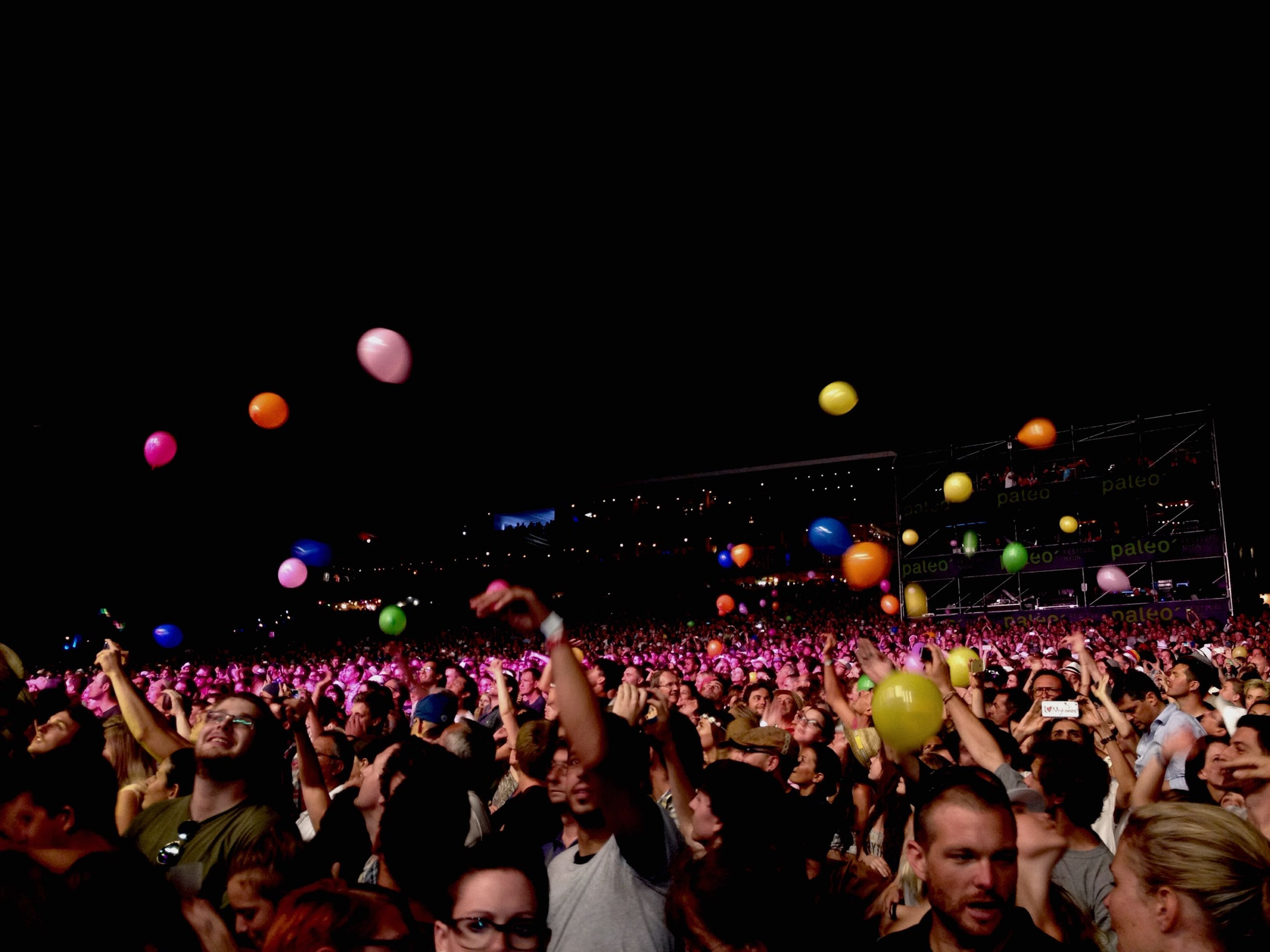 large group of people, crowd, illuminated, night, lifestyles, leisure activity, person, celebration, enjoyment, men, arts culture and entertainment, fun, event, music, performance, music festival, lighting equipment, togetherness