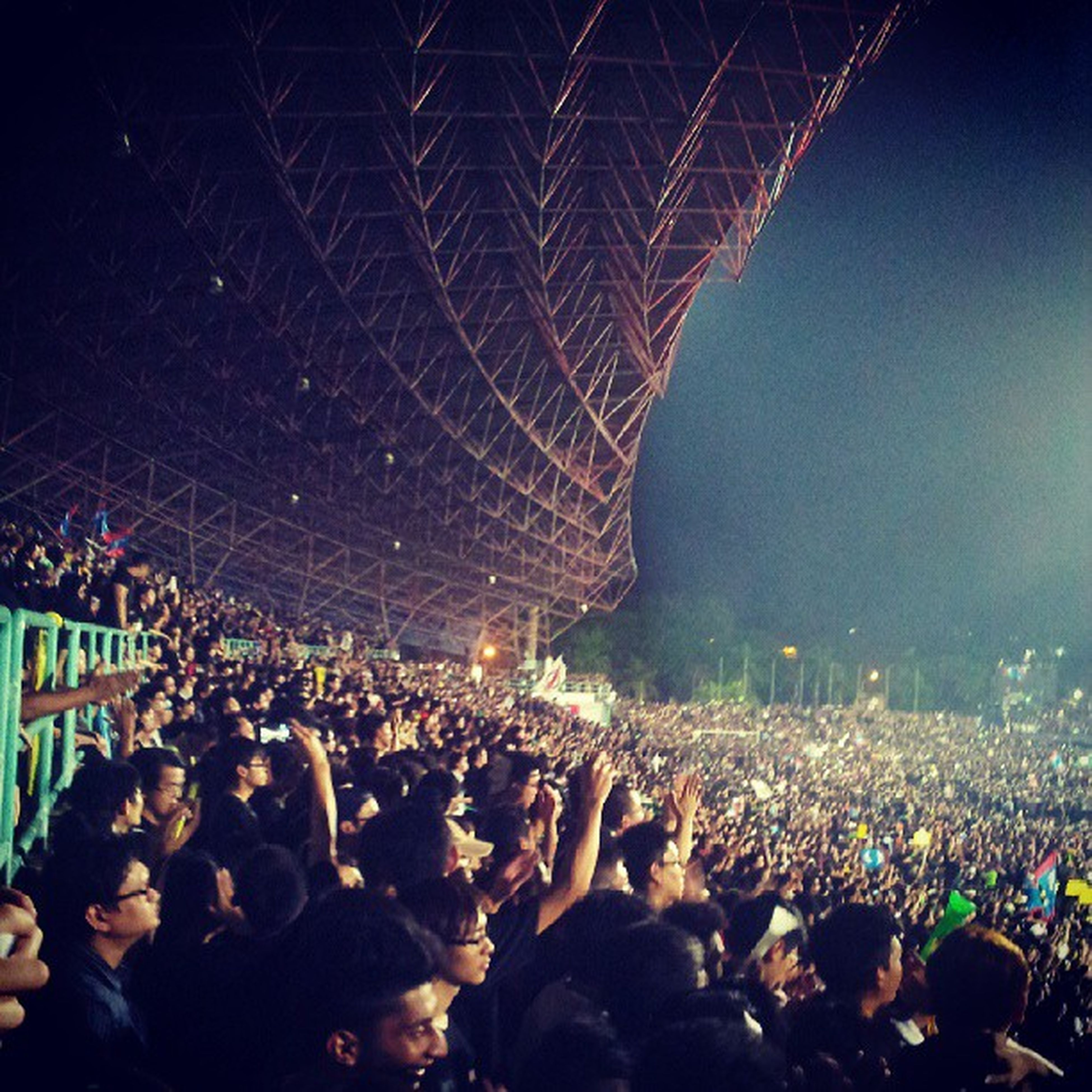 illuminated, large group of people, night, crowd, lifestyles, leisure activity, men, arts culture and entertainment, celebration, enjoyment, person, event, music festival, fun, music, togetherness, concert, stage - performance space