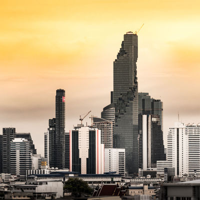 Bangkok city with skyscraper Architecture Building Building Exterior Built Structure Capital City City Cityscape Cityscapes Cloud Cloud - Sky Cloudy Crane - Construction Machinery Development Metropolis Modern No People Office Building Orange Color Outdoors Sky Skyscraper Sunset Taking Photos Tall Tall - High