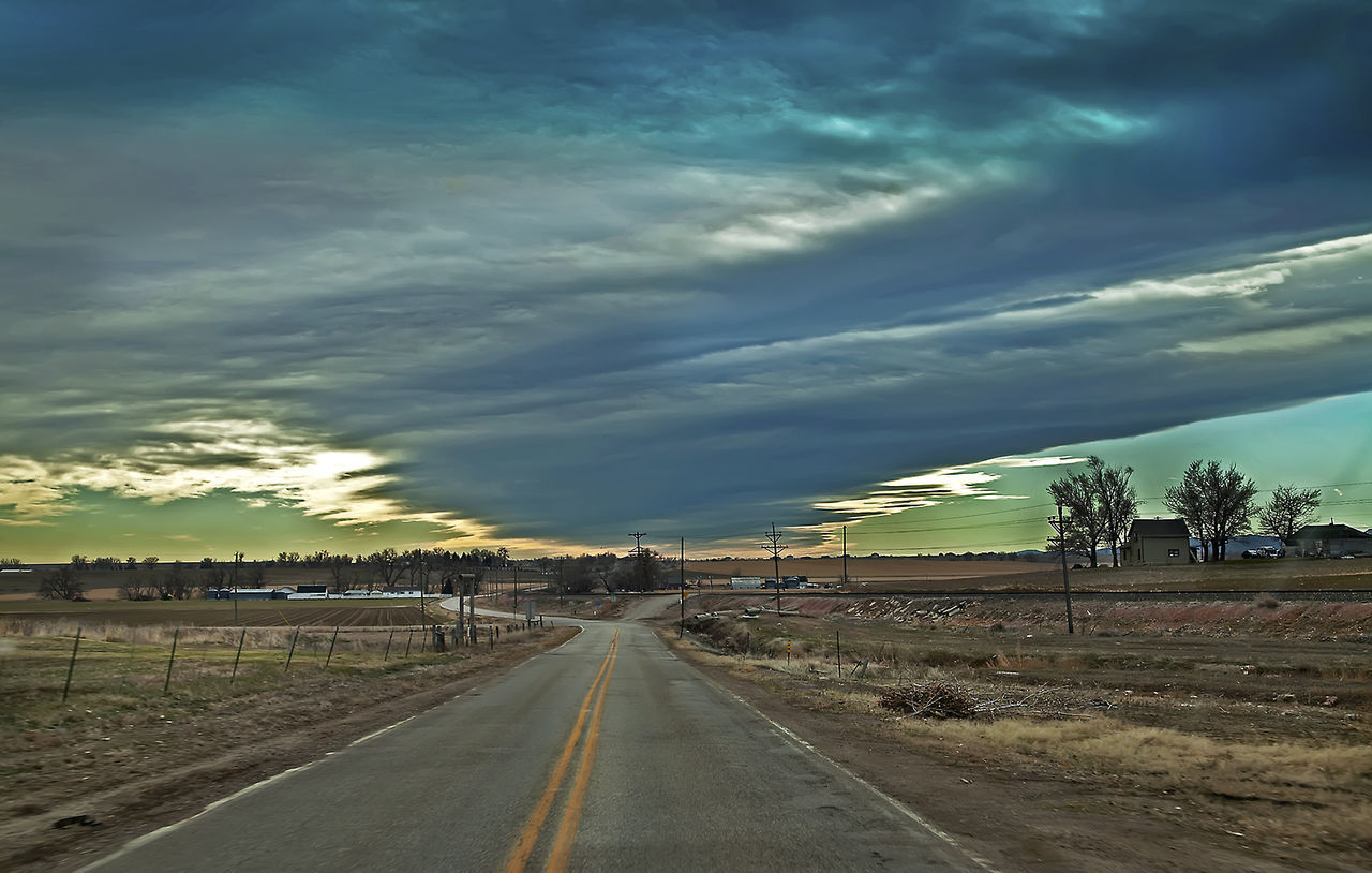 Cloud - Sky Distant Dramatic Sky Goin' Down The Road Journey Moody Sky On The Road Outdoors Overcast Road Rodie The Long And Winding Road! The Great Outdoors - 2016 EyeEm Awards The Great Outdoors With Adobe Fine Art Photography On The Way