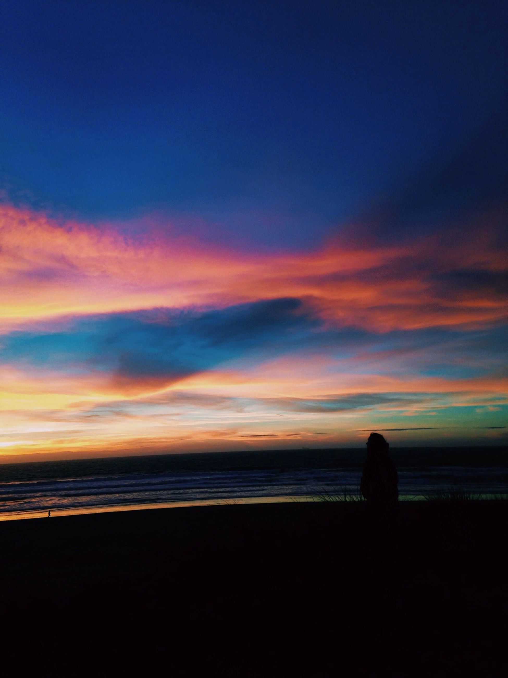 sunset, sea, silhouette, horizon over water, water, sky, scenics, beauty in nature, tranquil scene, tranquility, beach, orange color, shore, idyllic, nature, cloud - sky, standing, dusk, cloud