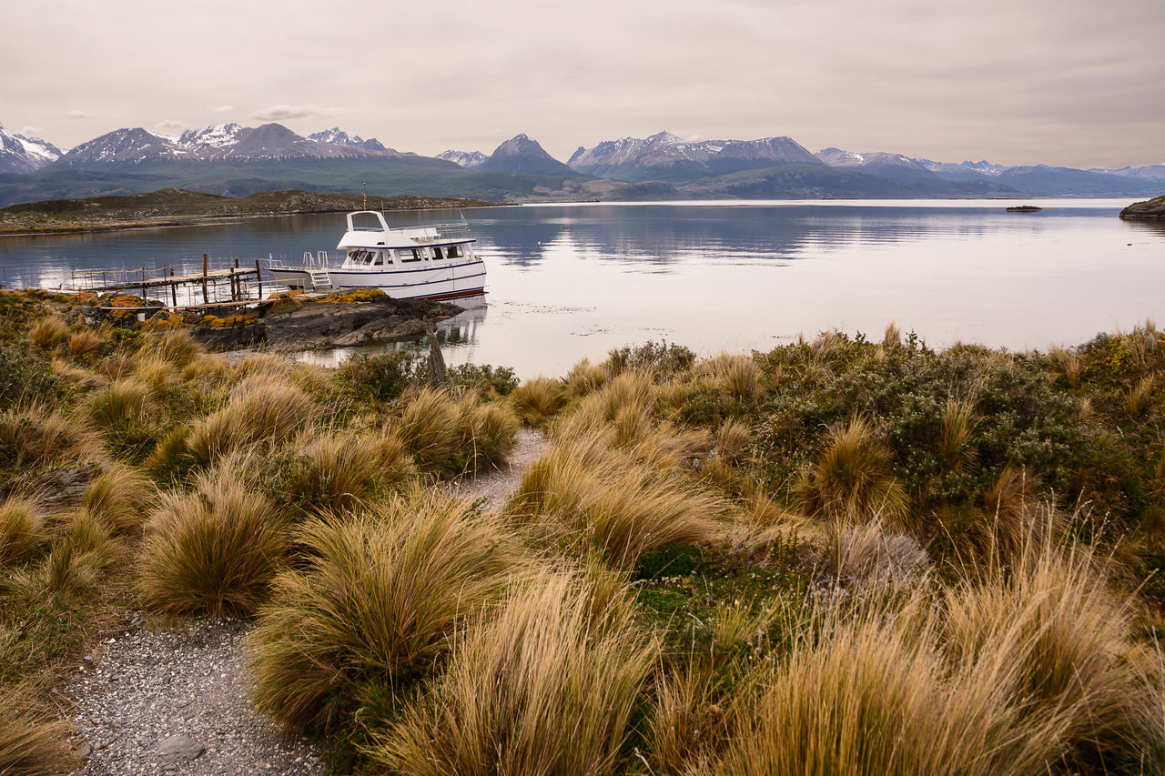 Bay in the Beagle channel - Land of Fire Andes Argentina Bay Beagle Channel Boat Clouds Laguna Land Of Fire Landscape Mountain Overcast Patagonia Port Ship Southernmost Tierra Del Fuego Ushuaïa Water