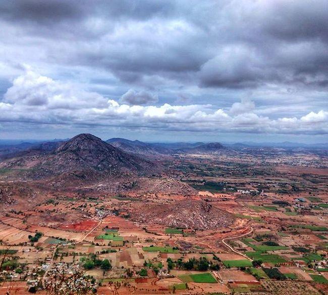 The plains, a hump and clouds Karnataka Nandi Clouds IndiaTrail