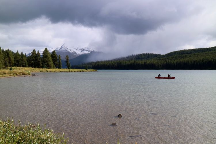 Maligne Lake Alberta Kayaking Lake Maligne Lost In The Landscape Rain Travel Travel Photography Beauty In Nature Canada Clouds Forest Jasper Jasper National Park Kayak Lake Landscape Maligne Lake Nature Outdoors Scenics