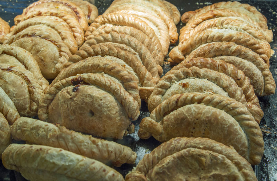 Cornish Pasties on sale in a shop at Padstow Cornish Pasty Cornish Pastie Baked Bakery Bread Close-up Day Food Food And Drink Freshness Homemade Indoors  Large Group Of Objects No People Puff Pastry Traditional Food