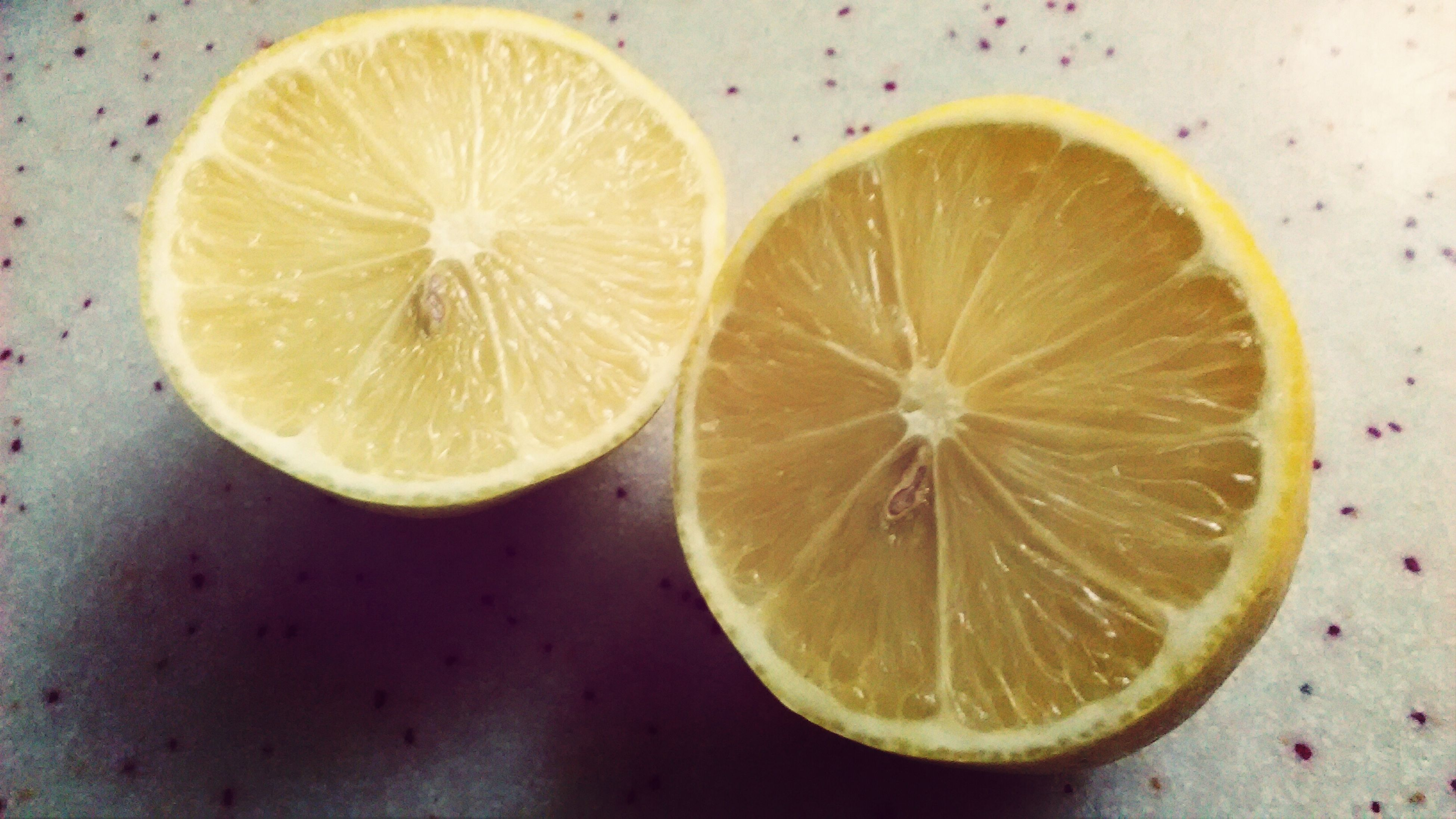 food and drink, freshness, healthy eating, food, fruit, cross section, slice, still life, close-up, indoors, halved, table, citrus fruit, directly above, orange - fruit, lemon, seed, refreshment, high angle view, no people